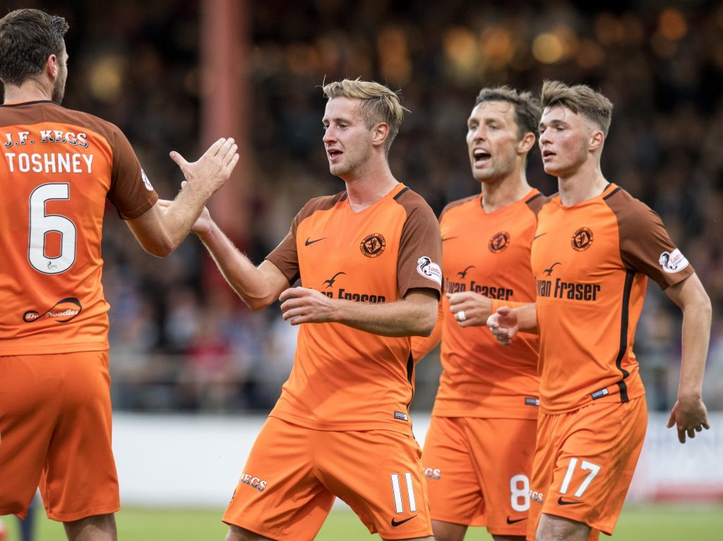 Dundee United's Billy King celebrates his equaliser