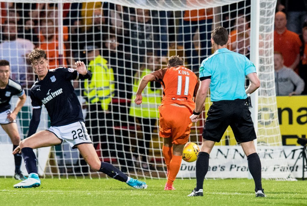 Dundee United's Billy King misses a late chance