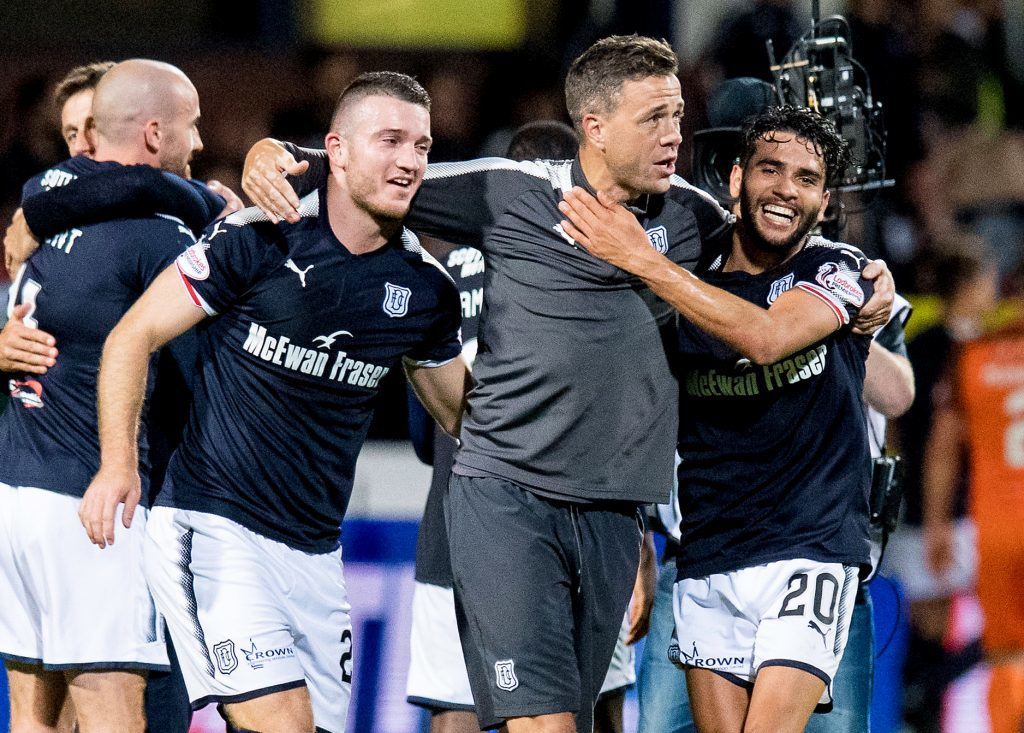 Dundee's Randy Wolters and Faissal El Bakhtaoui celebrate with assistant manager Graham Gartland at full time