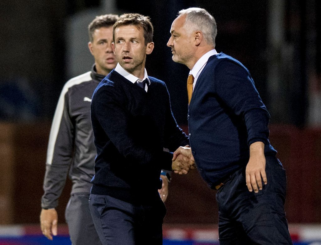 Dundee manager Neil McCann shakes hands with Dundee United manager Ray McKinnon