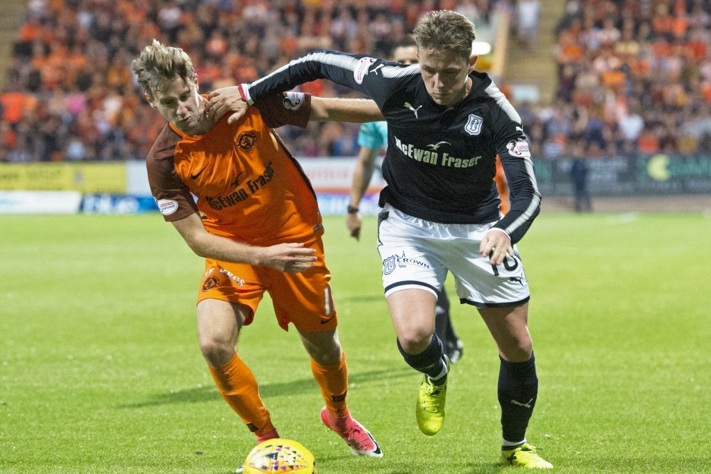 Dundee United's Billy King in action with Dundee's Scott Allan.