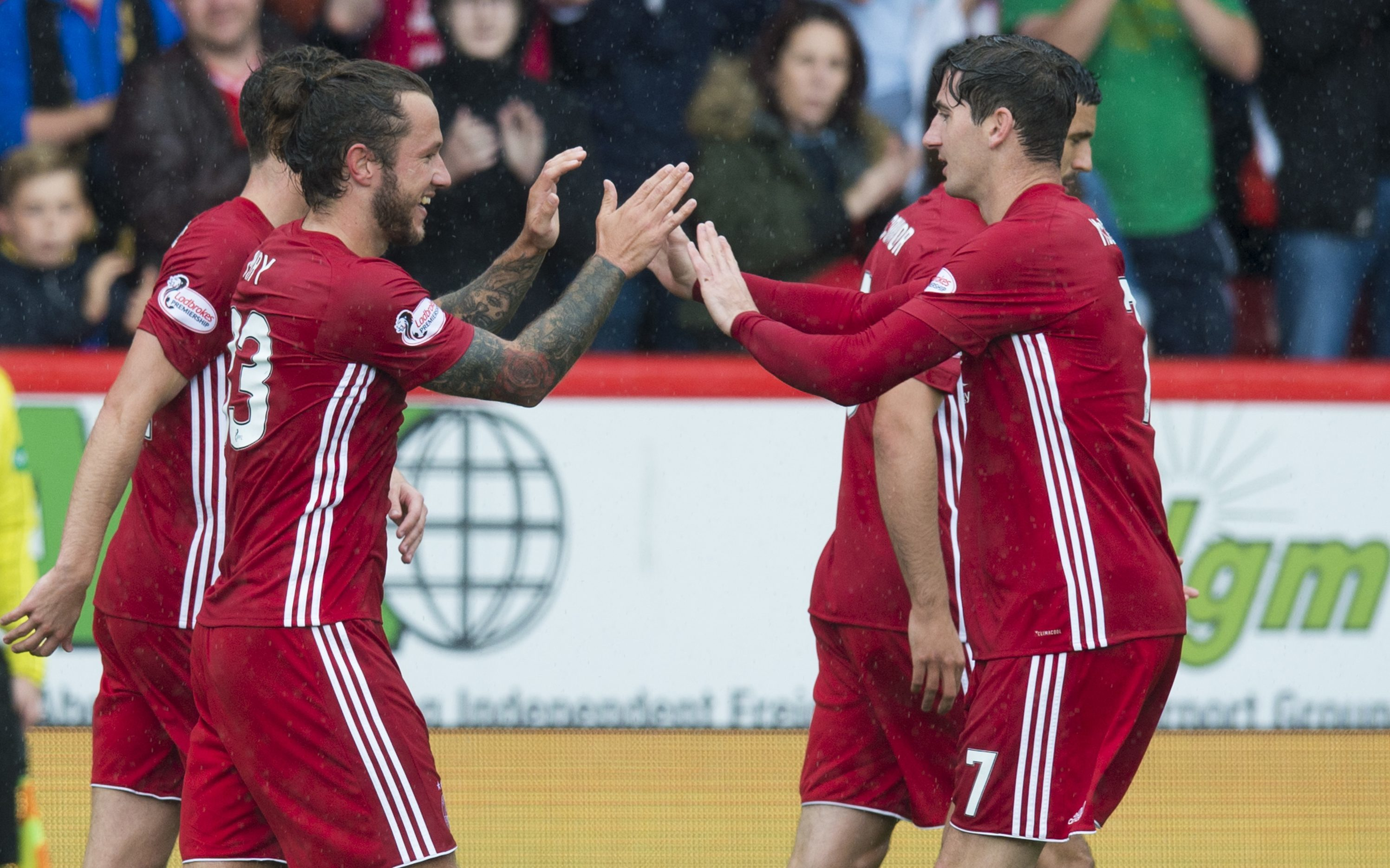 Stevie May (left) celebrates his goal with team-mate Kenny McLean.