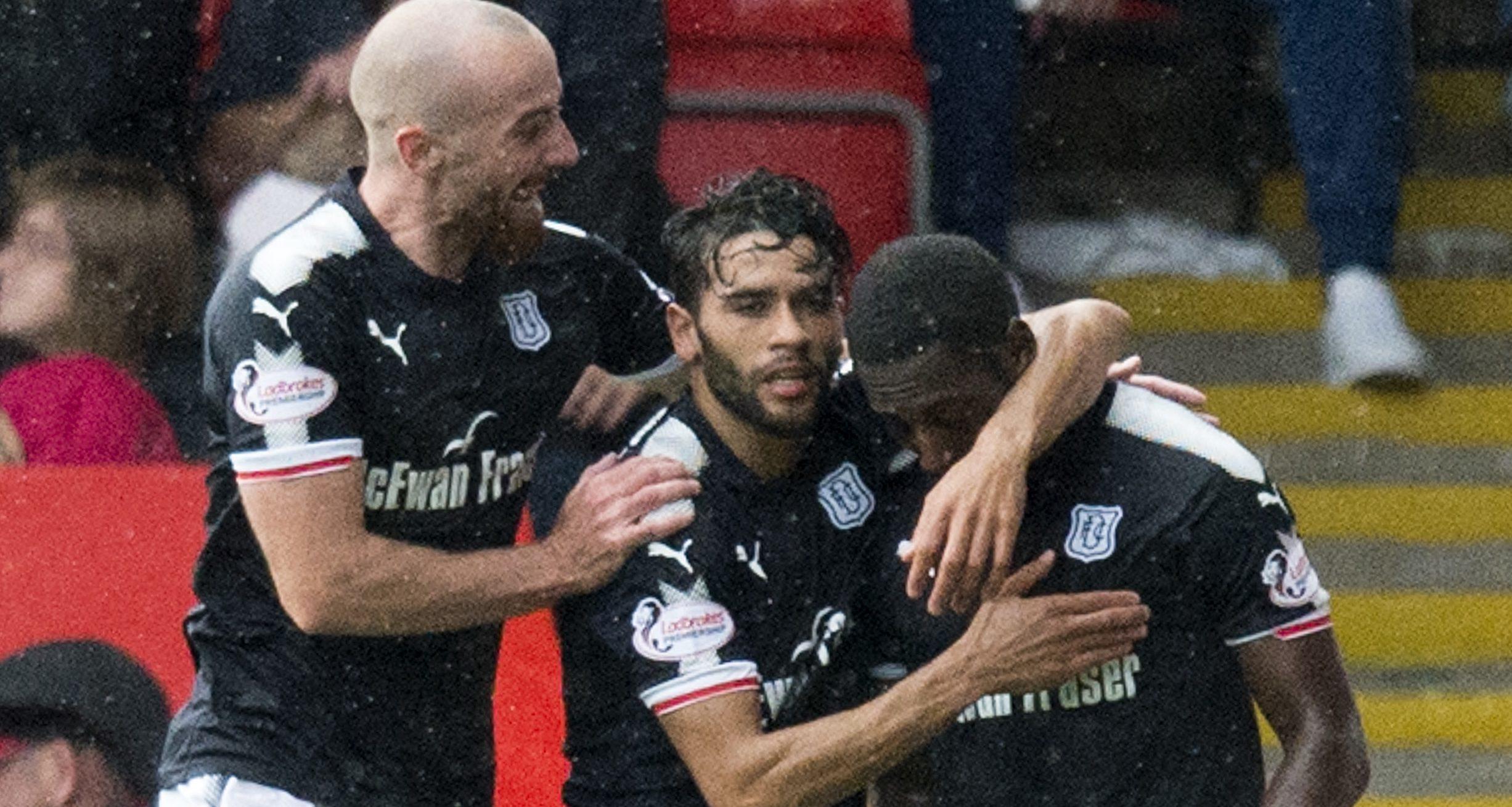 Roarie Deacon (right) celebrates his goal.