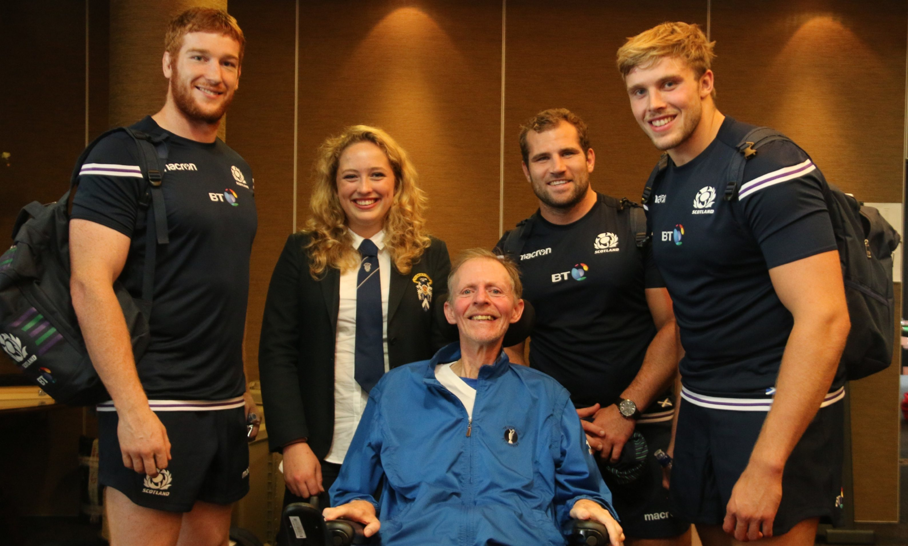 Brynja Duthie and former teacher Donald Grewar are pictured with Scottish rugby players (from left) Robert Harley, Fraser Brown and Jonny Gray