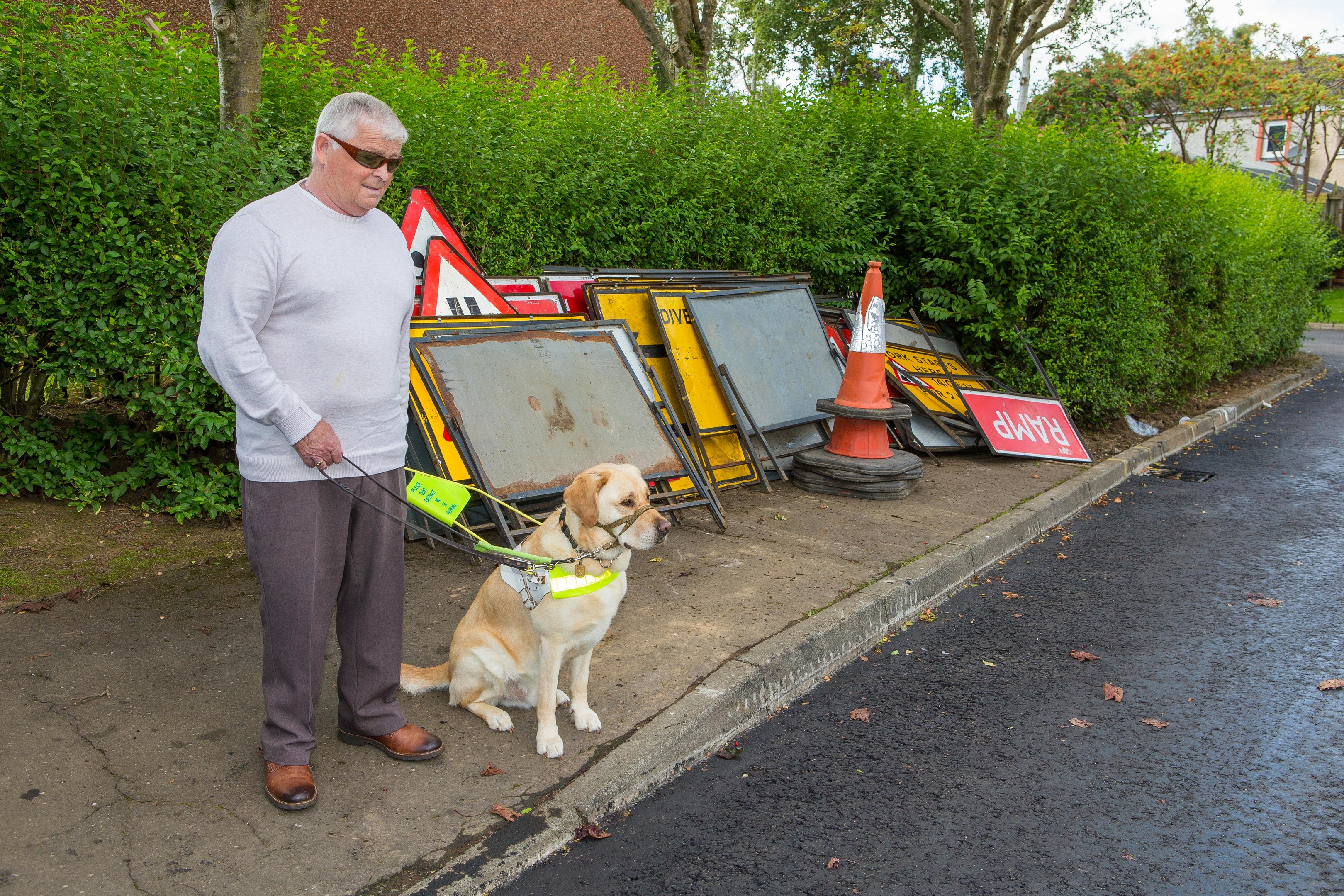 Iain Muir and his guide dog Tel.