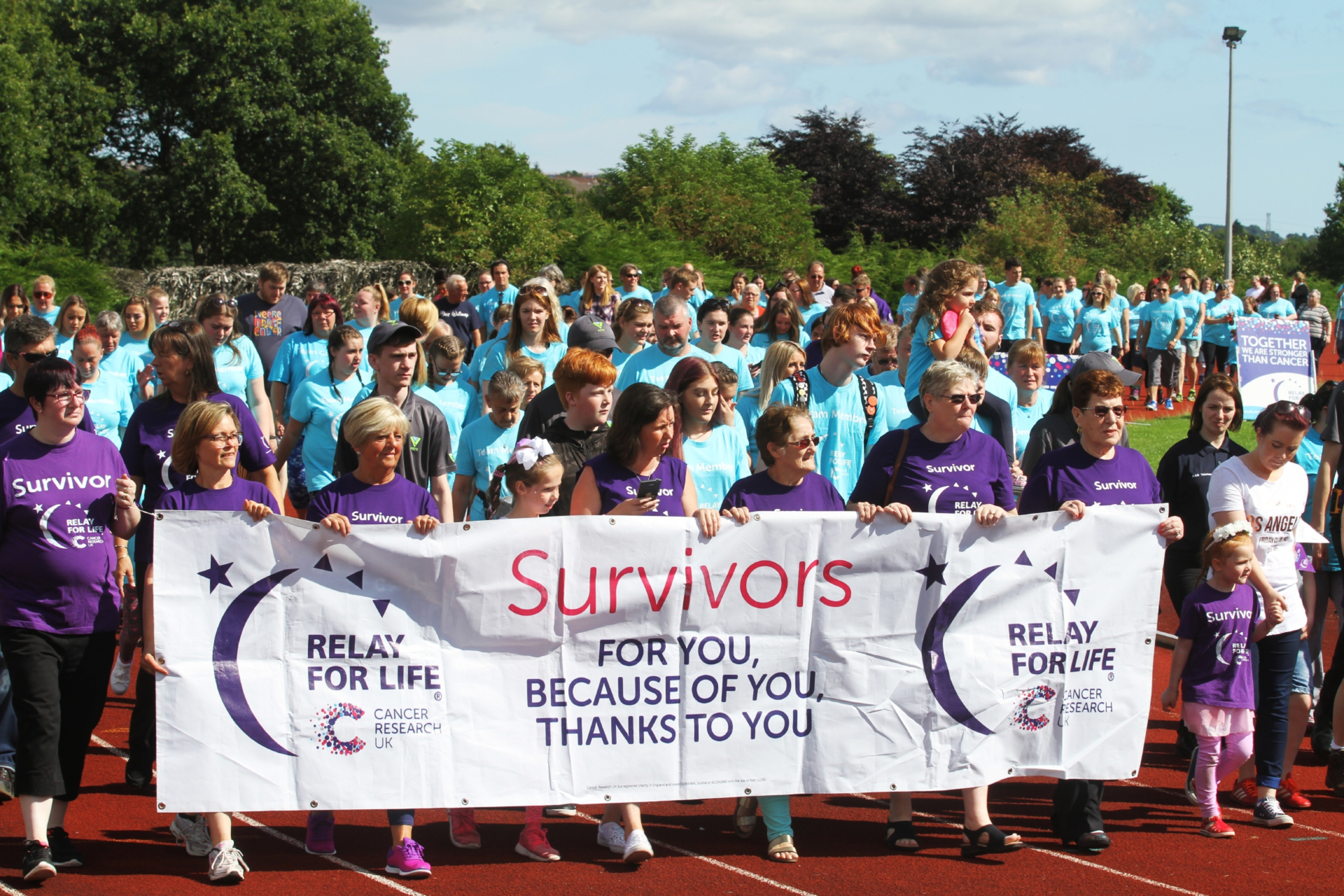 Cancer survivors opening the Relay For Life..