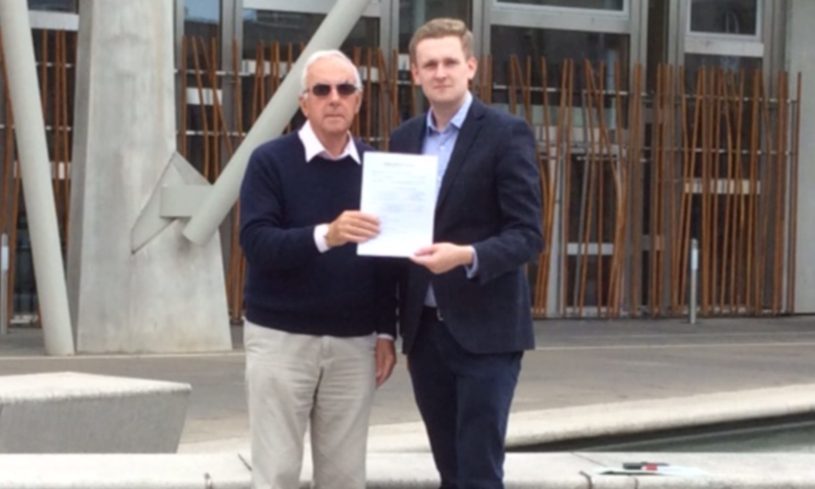 John Anderson (left) and Perth and Kinross Councillor Callum Purves with the petition calling on the Scottish Government to protect Blairingone from development.
