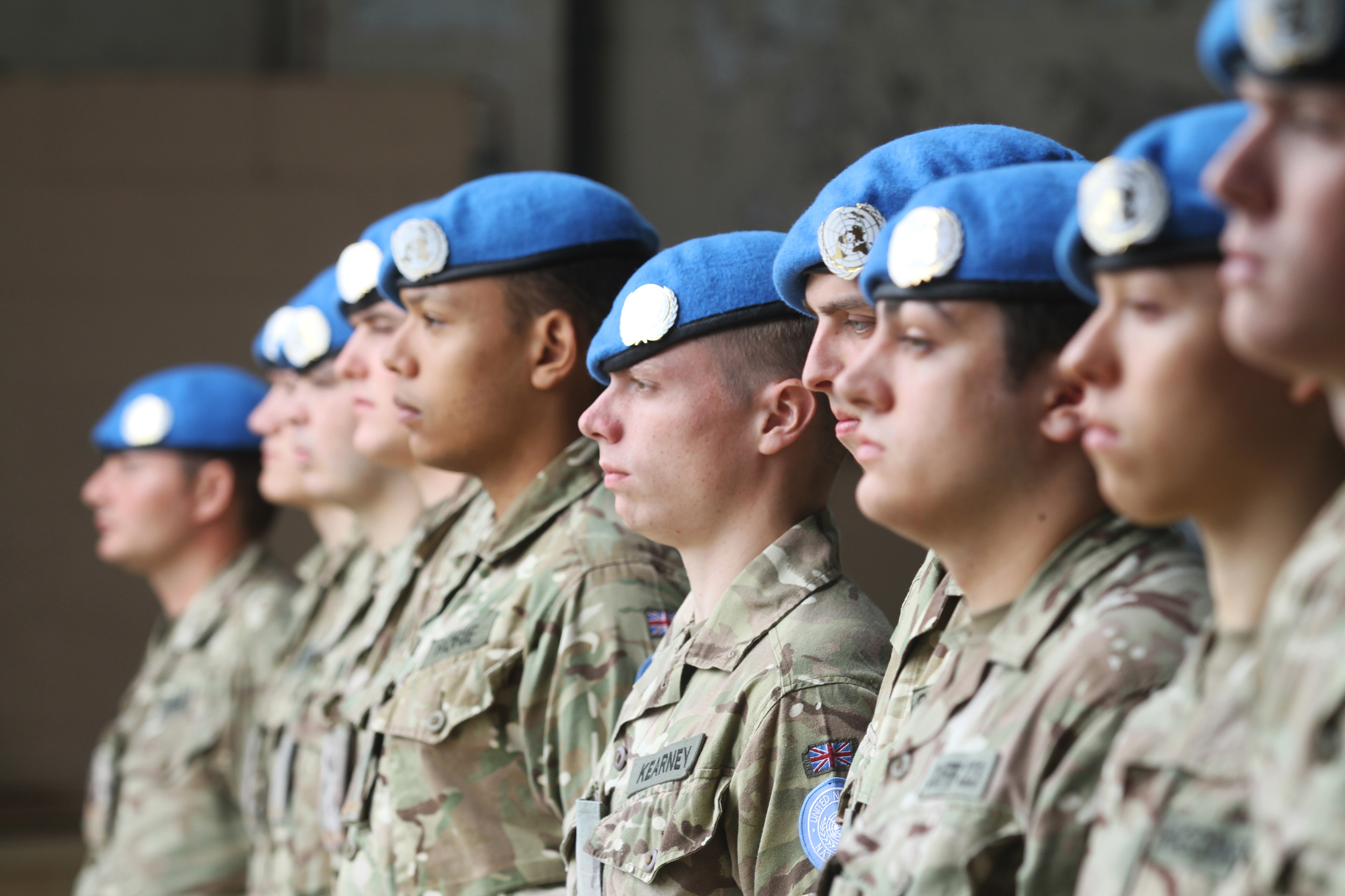 The soldiers with their UN blue berets and badges.