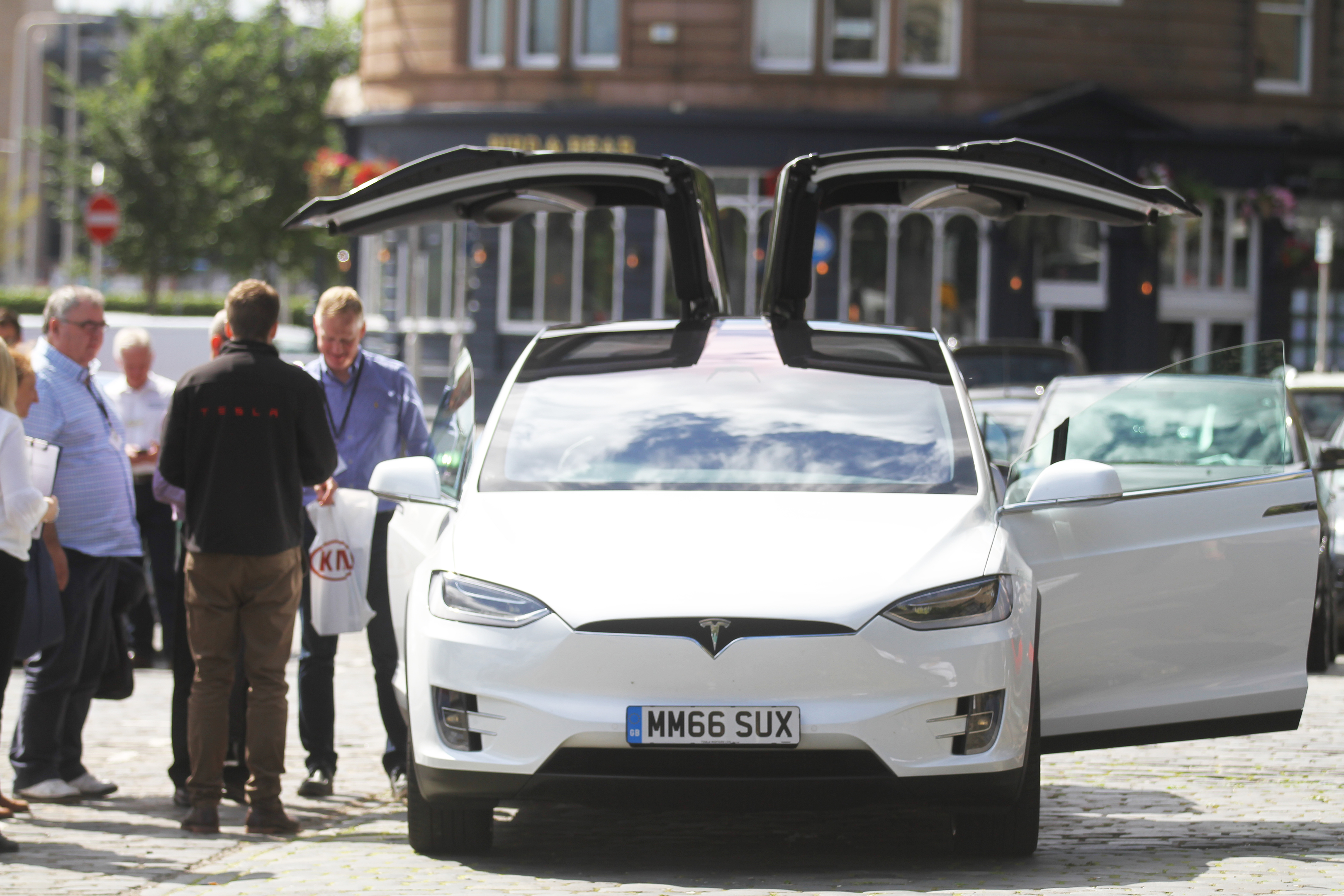 A Tesla with its doors open at GreenFleet Dundee