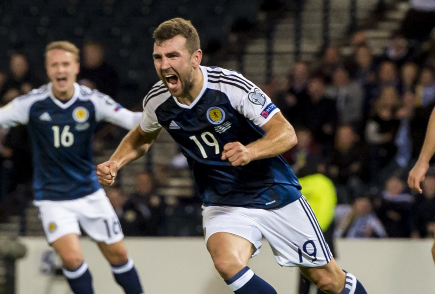 James McArthur after scoring against Lithuania.