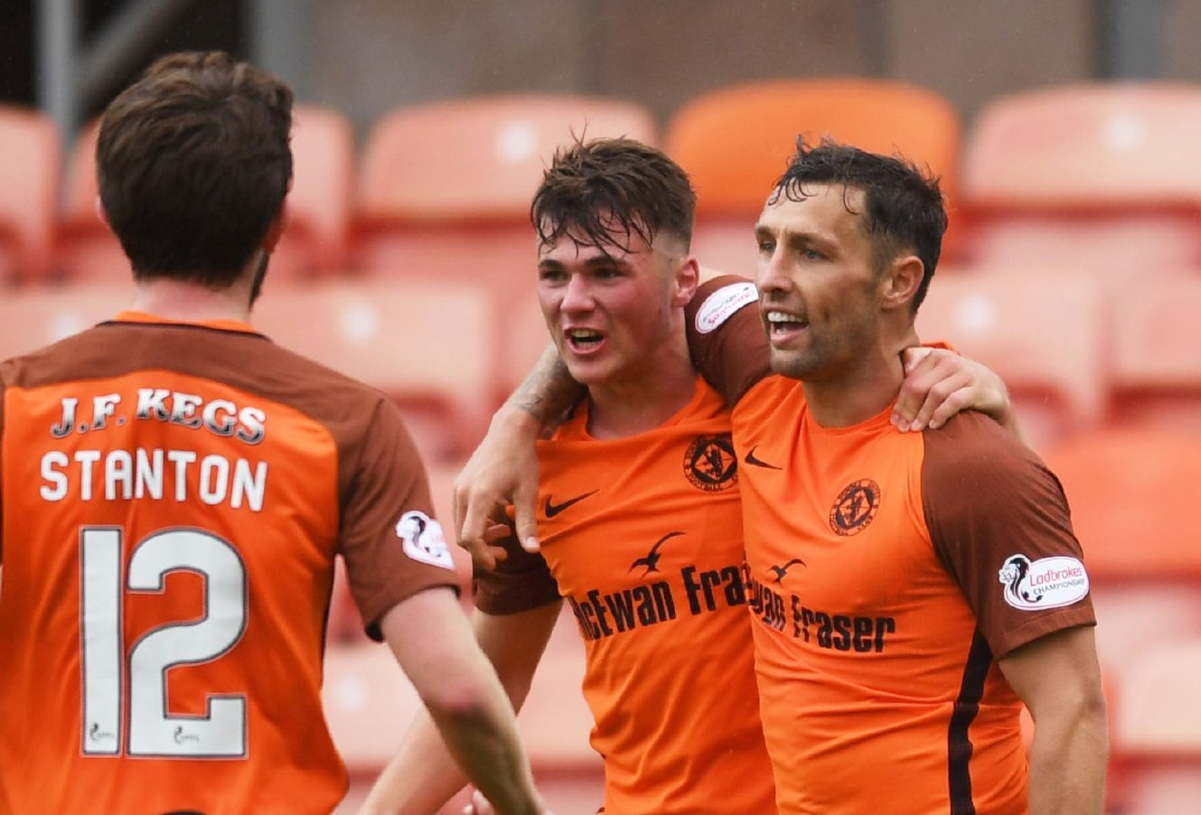 Scott McDonald (right) is congratulated after making it 1-0.