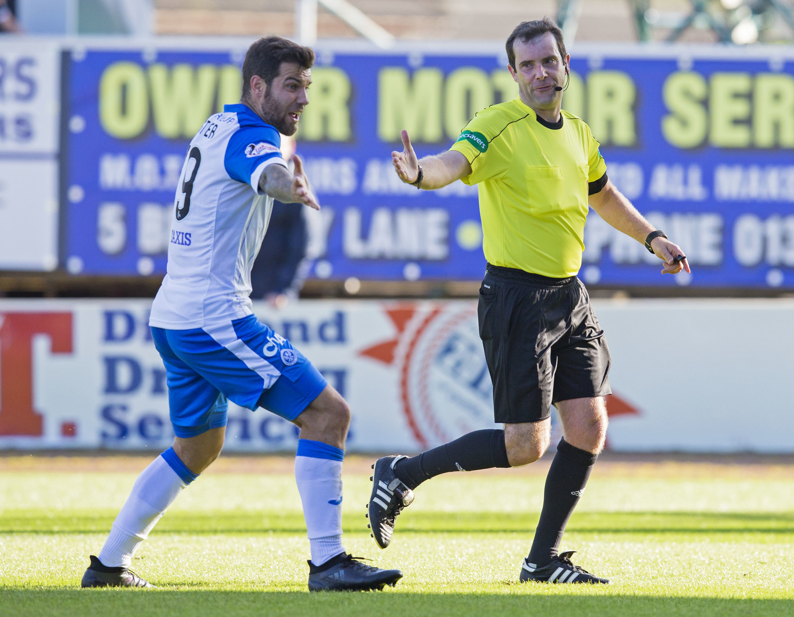 St Johnstone's Richard Foster speaks with referee Alan Muir after a penalty is awarded against him.