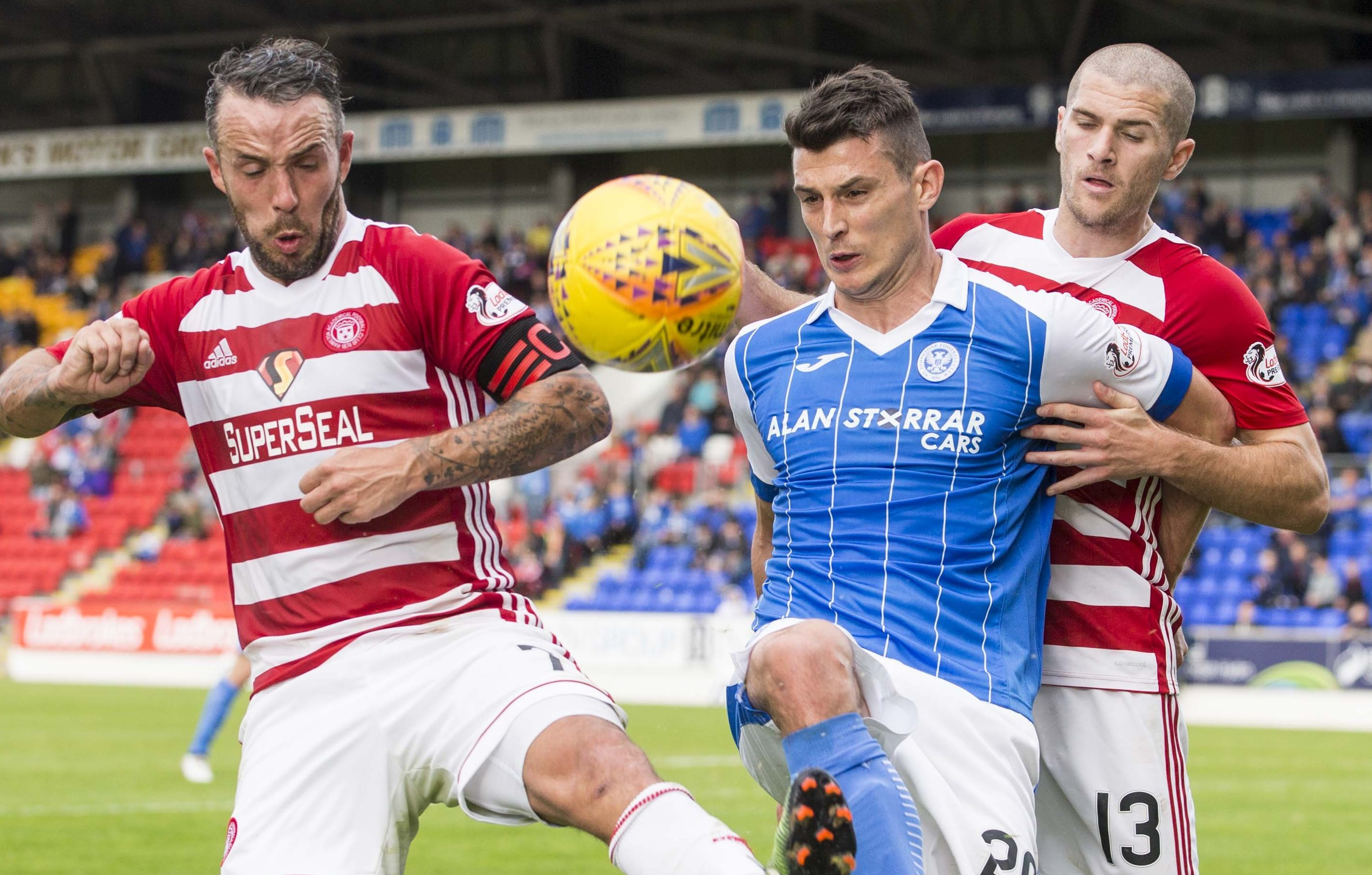 Hamilton's Dougie Imrie and Alex Gogic challenge St Johnstone's Graham Cummins.