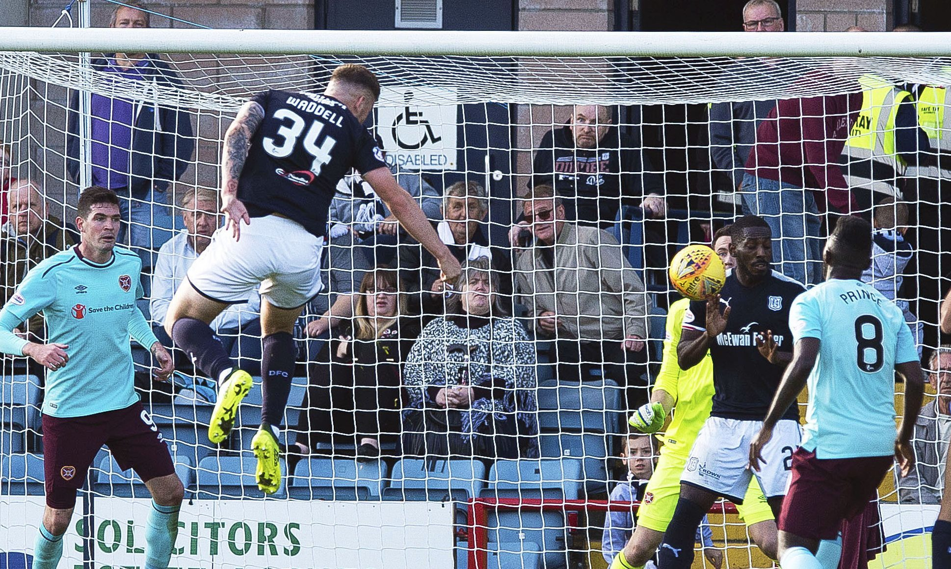 Kerr Waddell scores against Hearts for Dundee.