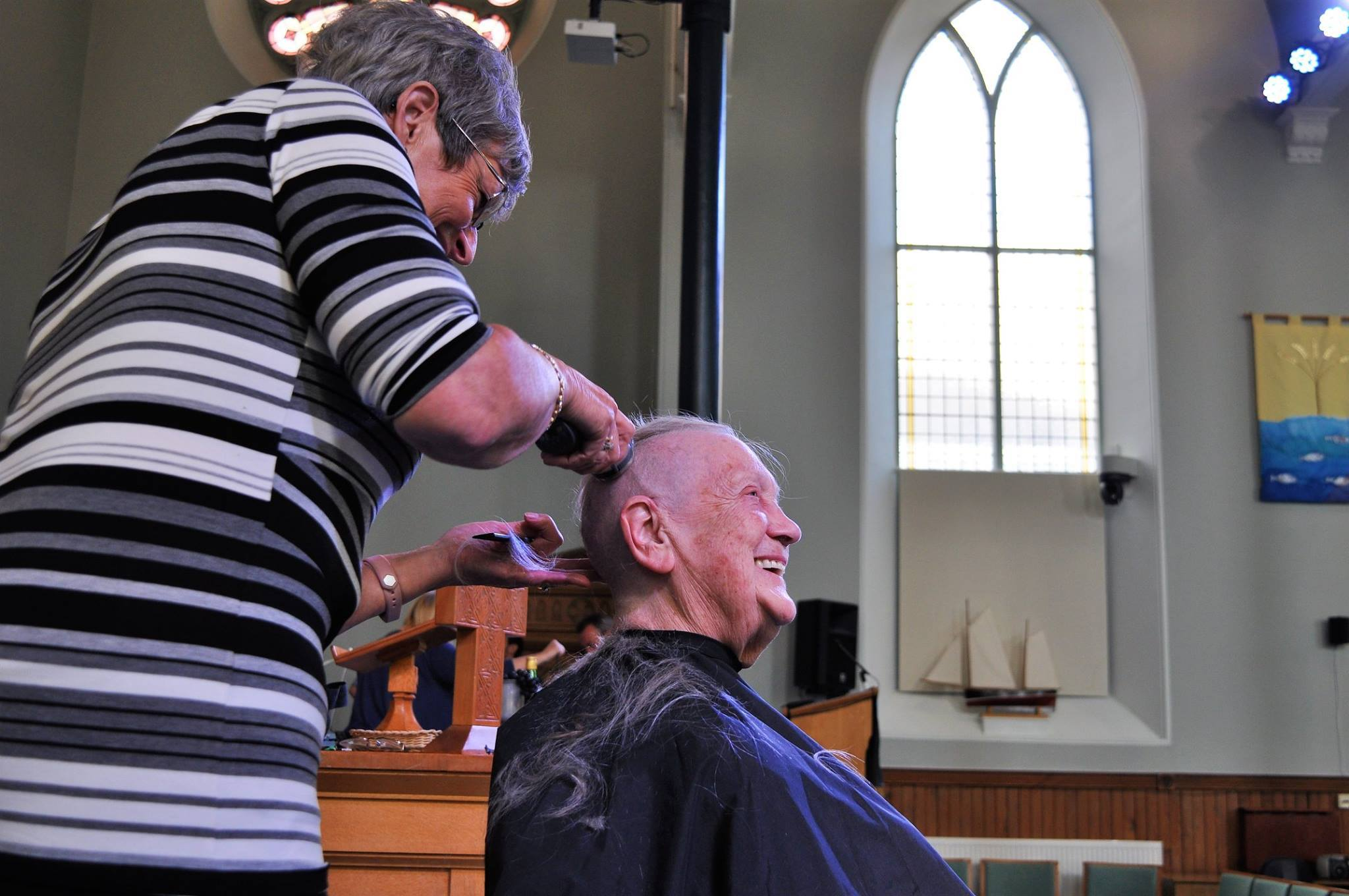 Mrs Smith goes under the clippers at the hands of fellow elder Noela Watson who used to run her own salon.