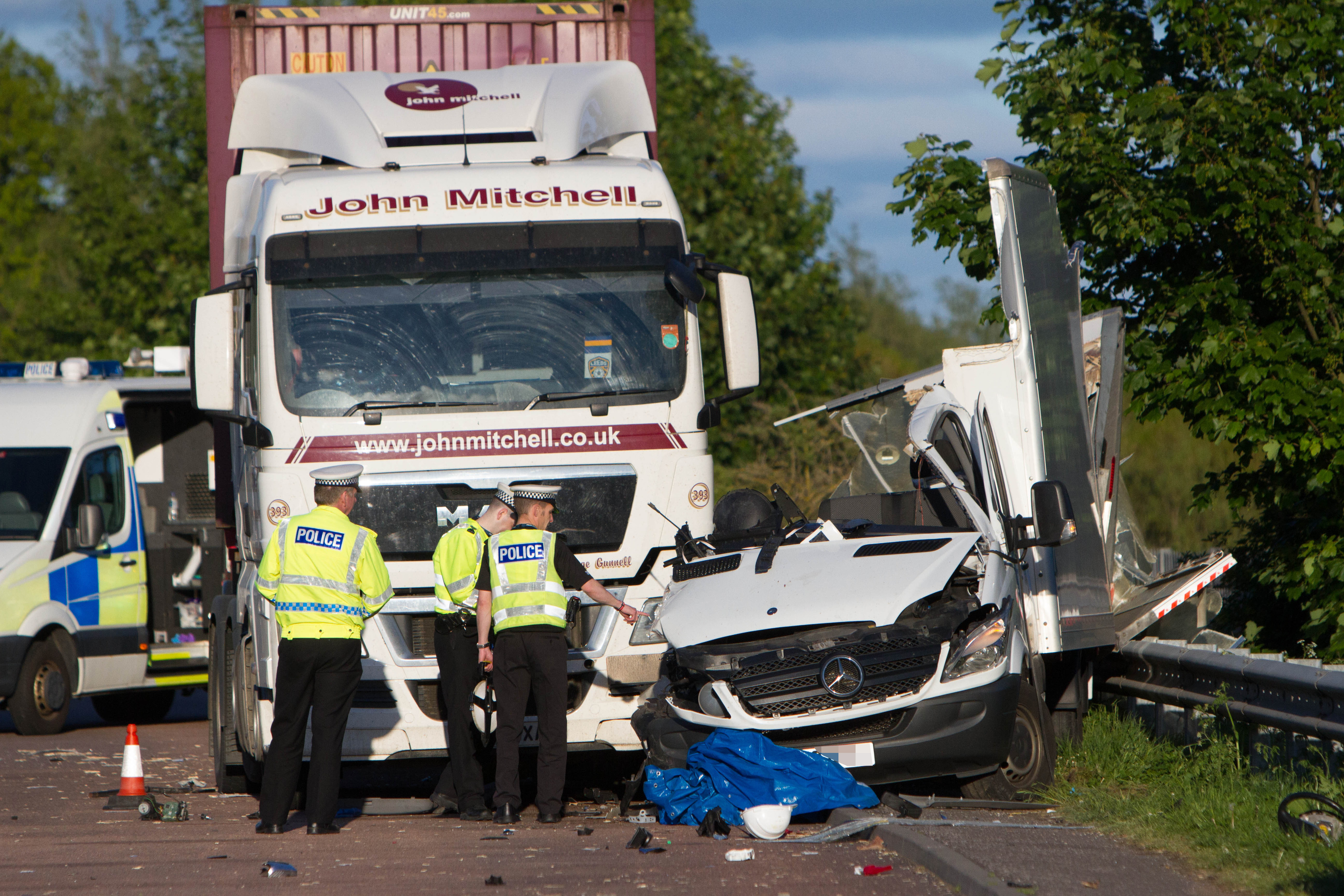 The Mercedes Sprinter van came to rest between the lorry cab and the crash barrier.