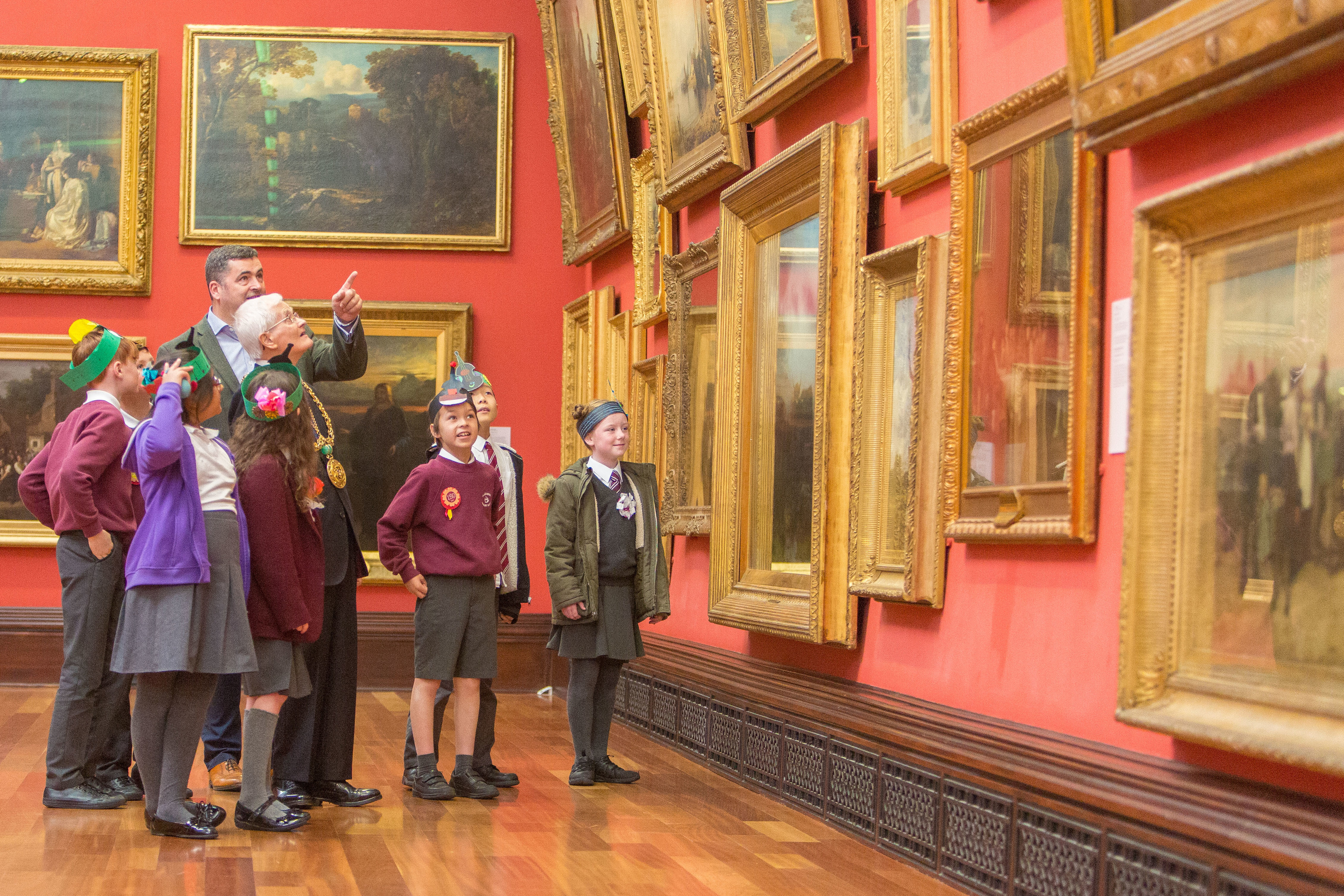 The Lord Provost Ian Borthwick enjoys a tour of the McManus with Billy Gartley, head of cultural services, and children from Blackness Primary.
