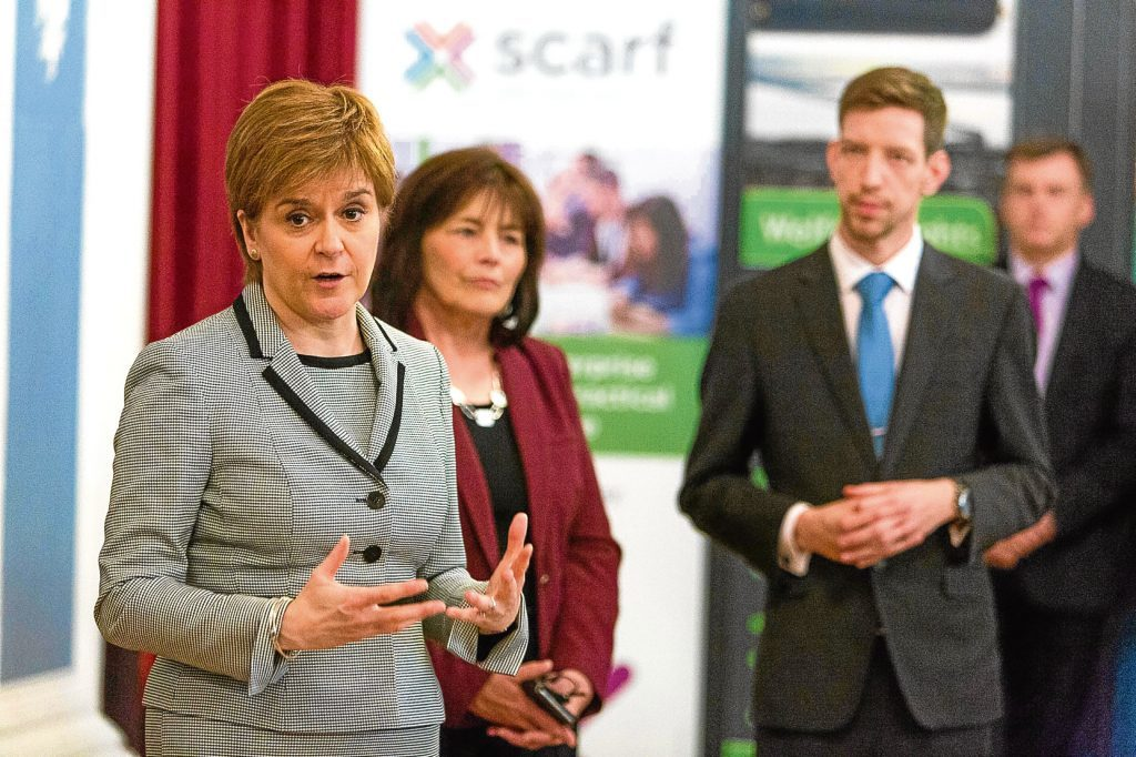 Nicola Sturgeon in Dundee with social security minister Jeane Freeman and council leader John Alexander