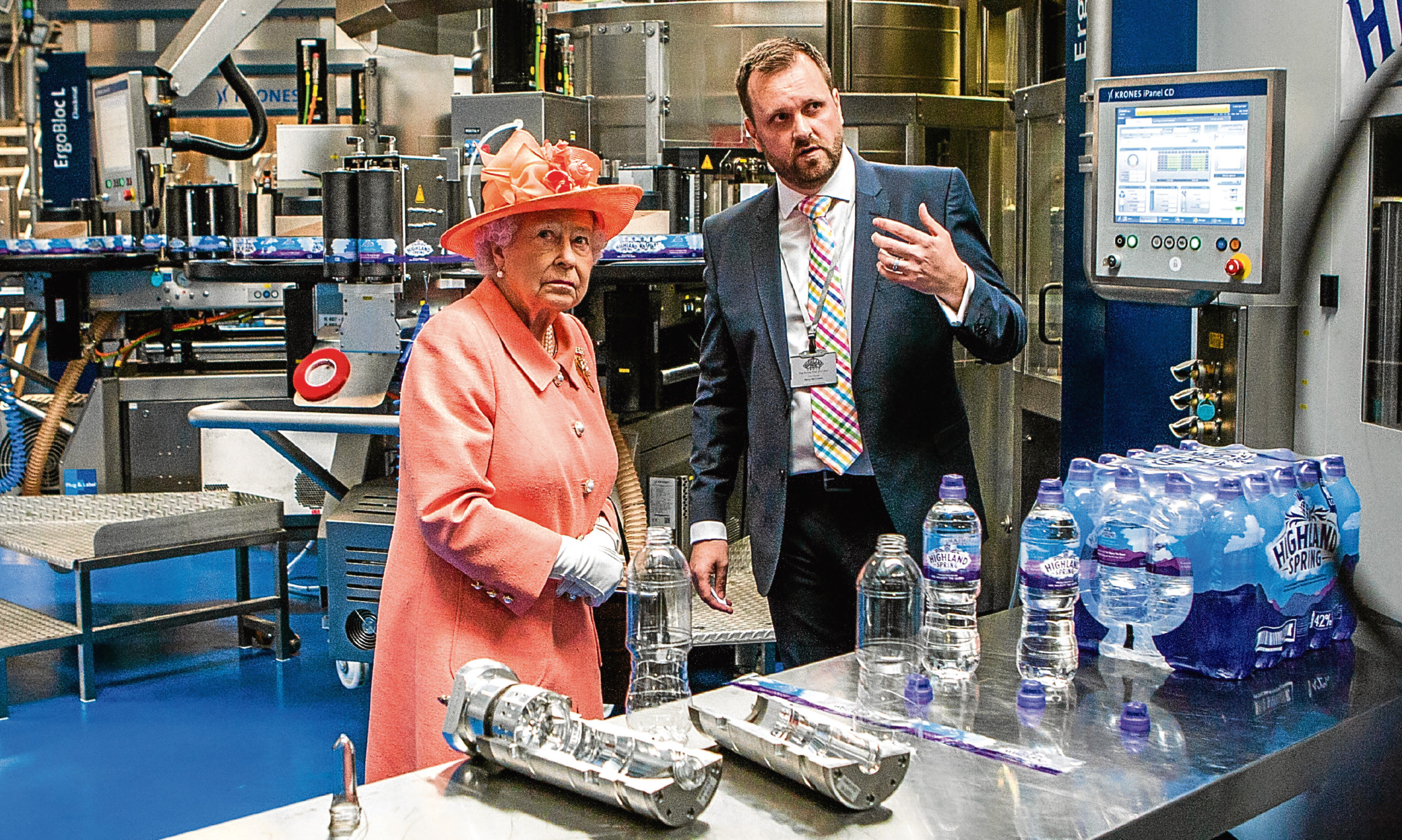 Top: The Queen was given a tour of the Highland Spring factory in Blackford in July by operations director Bryan McCluskey.