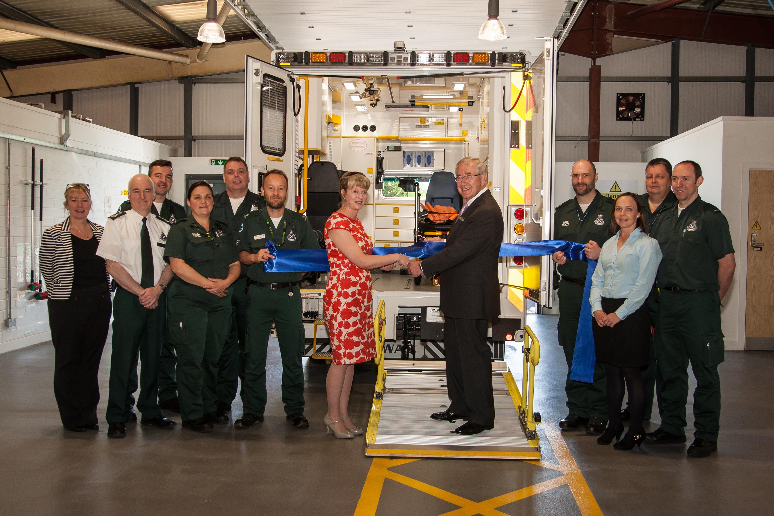 Shona Robison cutting the ribbon with David Garbutt, chairman Scottish Ambulance Service.