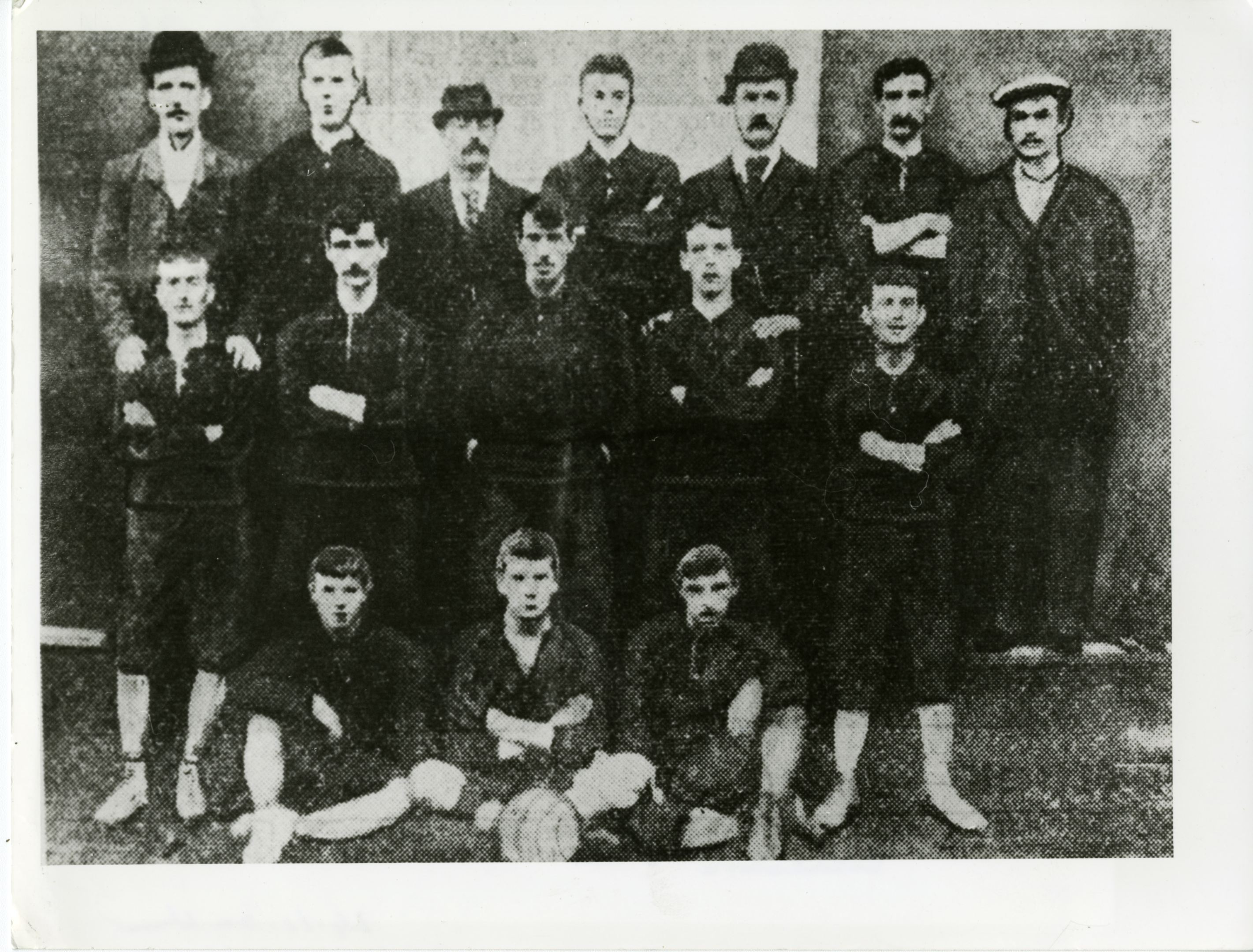 "Arborath FC 1885-09- The record breaking Arbroath Football Club team sitting behind the ball is John ""Jockey"" Petrie who scored 13 goals from the outside right position at the Scottish Cup match against Bon Accord on 12 September 1885."