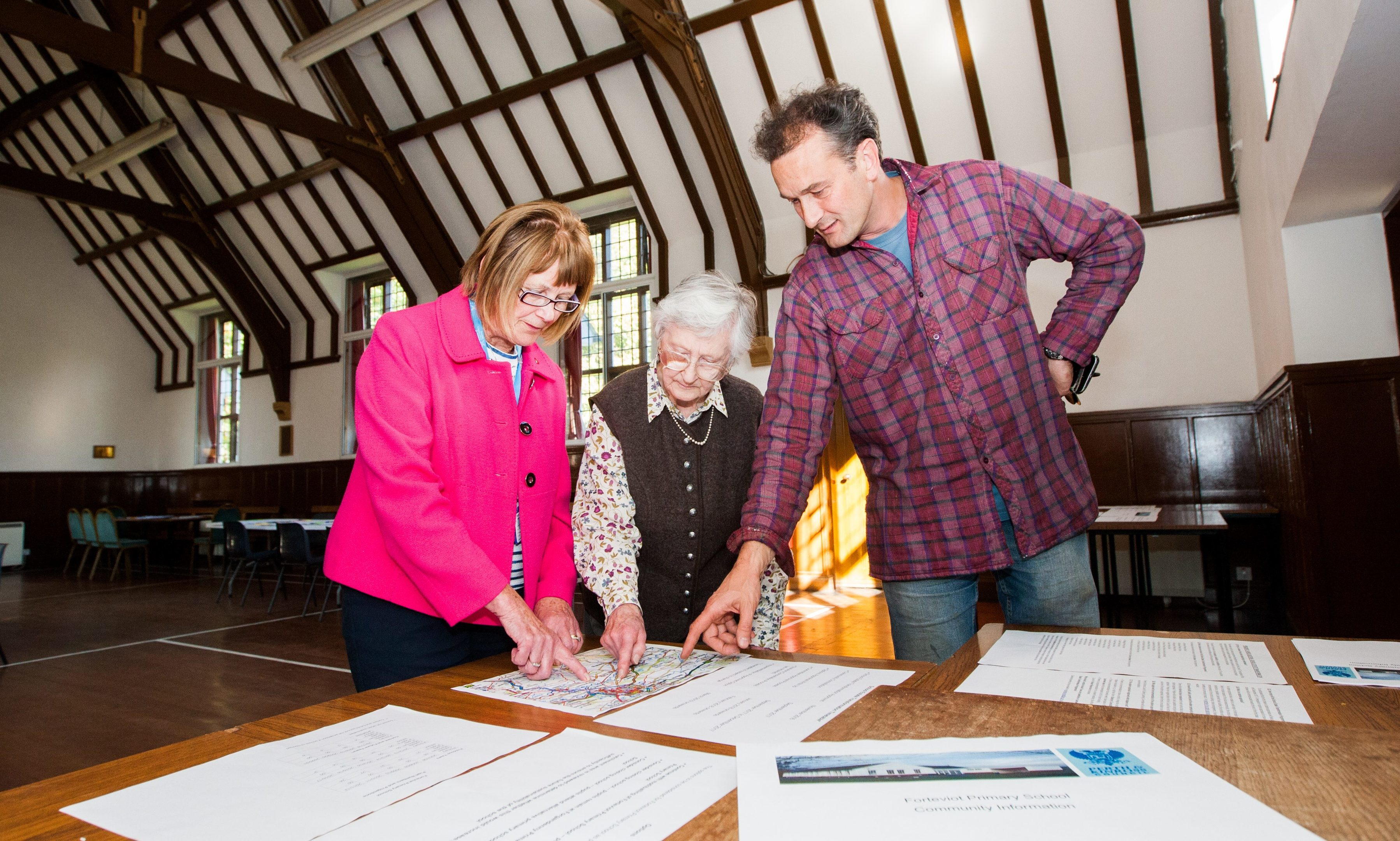 Councillor Kathleen Baird, Diana Roff (Earn Community Council) and Alexander Dewar (Dupplin Estate) consider proposals at the Village Hall, Forteviot.
