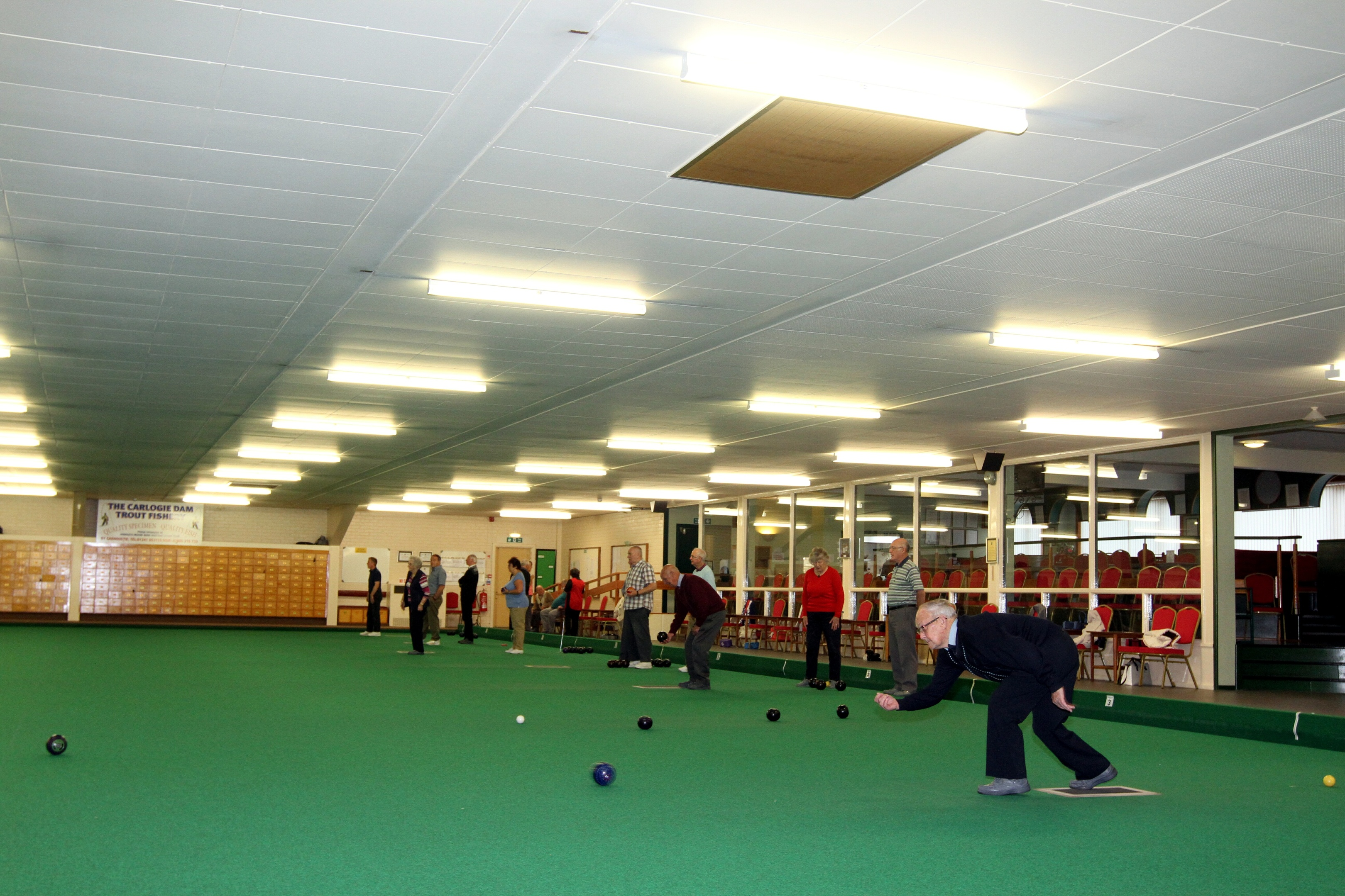 Bowlers in action at Arbroath & District Indoor Bowling Club.
