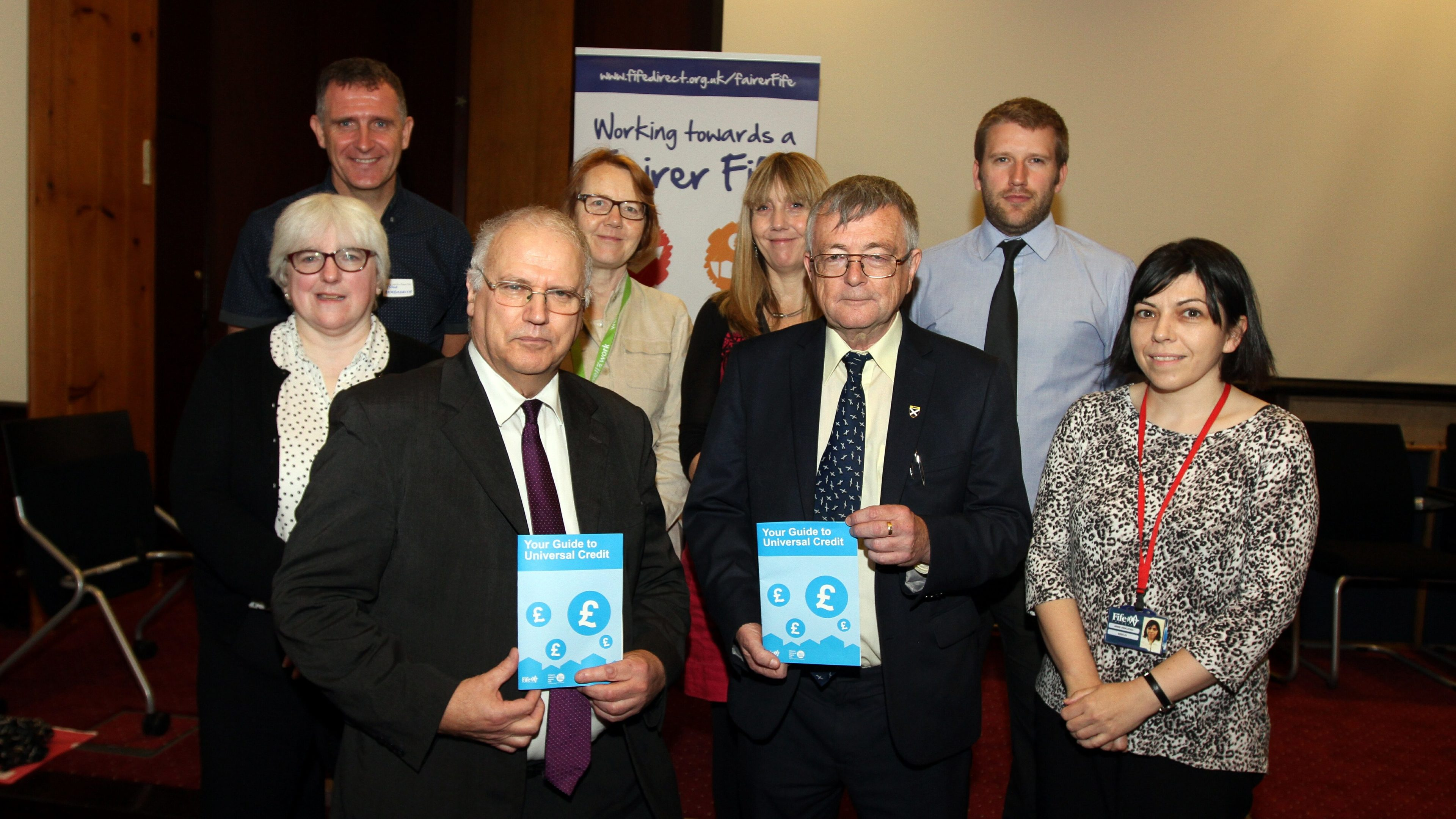 Councillor David Ross (front left) and Councillor David Alexander at the launch of Fife Council's advice leaflet into Universal Credit.