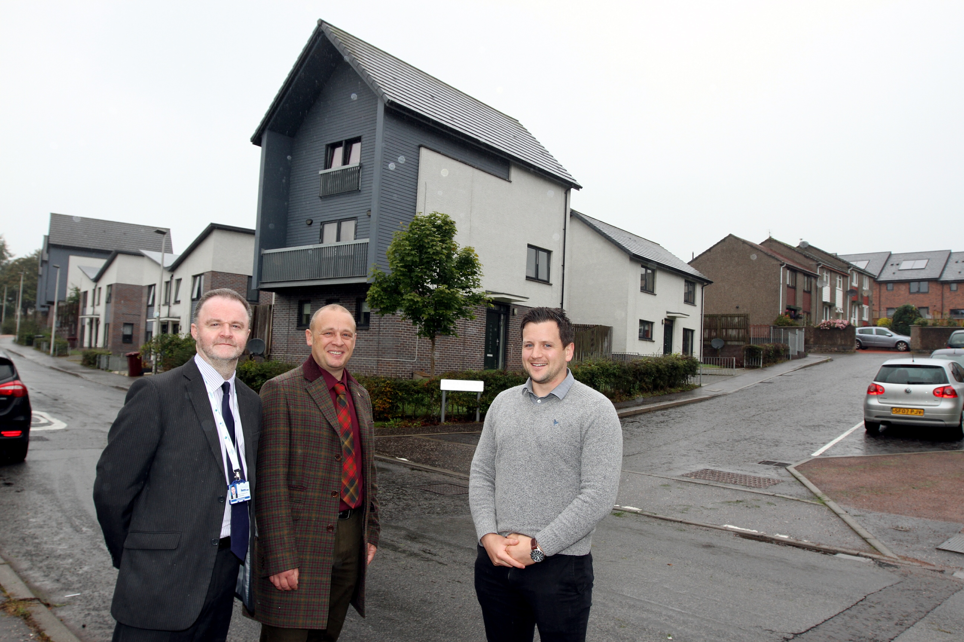 David Simpson, head of housing at Dundee City Council; Kevin Cordell, neighbourhood services convener; and Graeme Gemmell, delivery manager for Home Scotland visit the new homes in Mill O'Mains.
