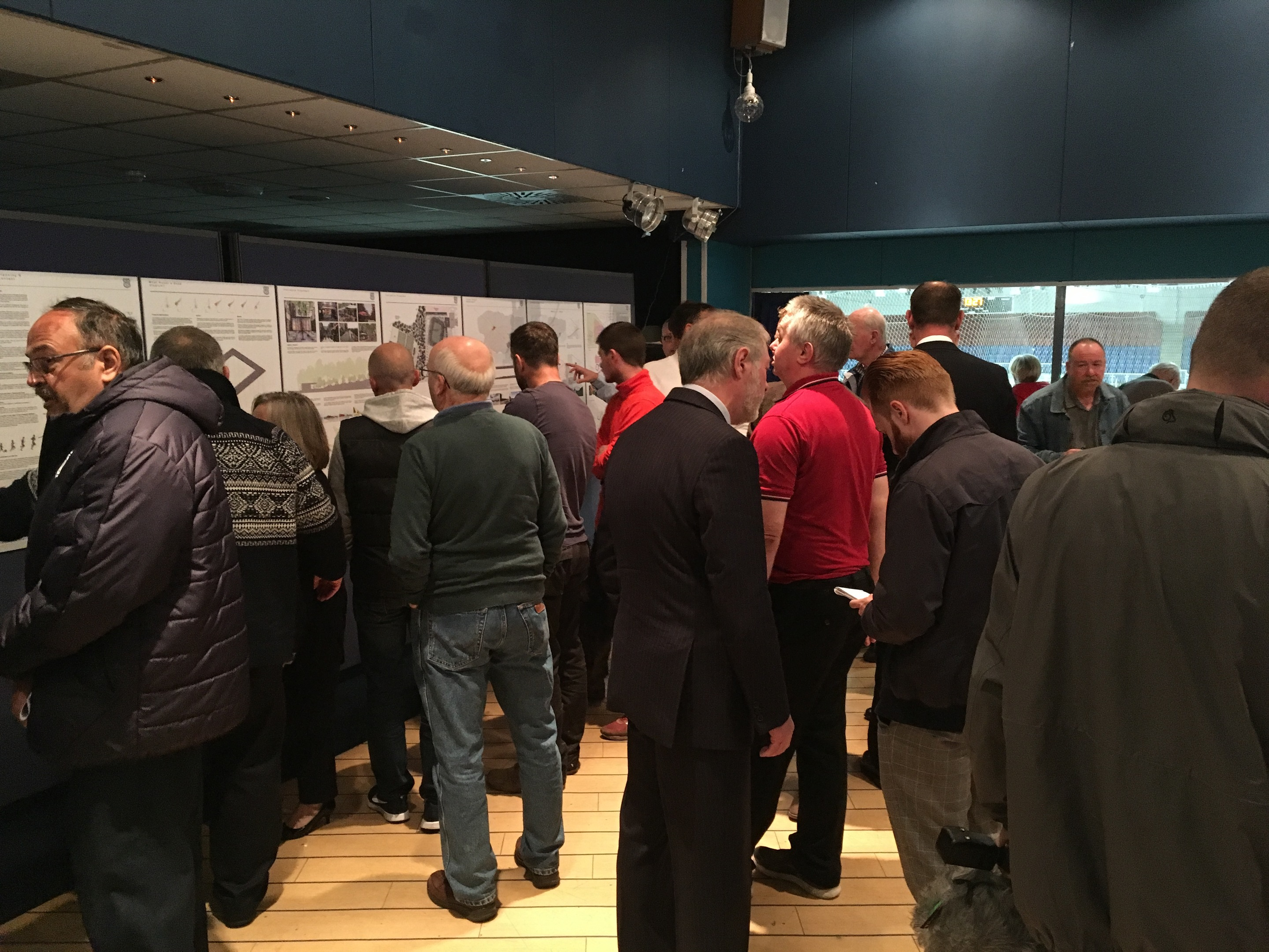 The public browsing the plans for a new stadium for Dundee FC at Camperdown.