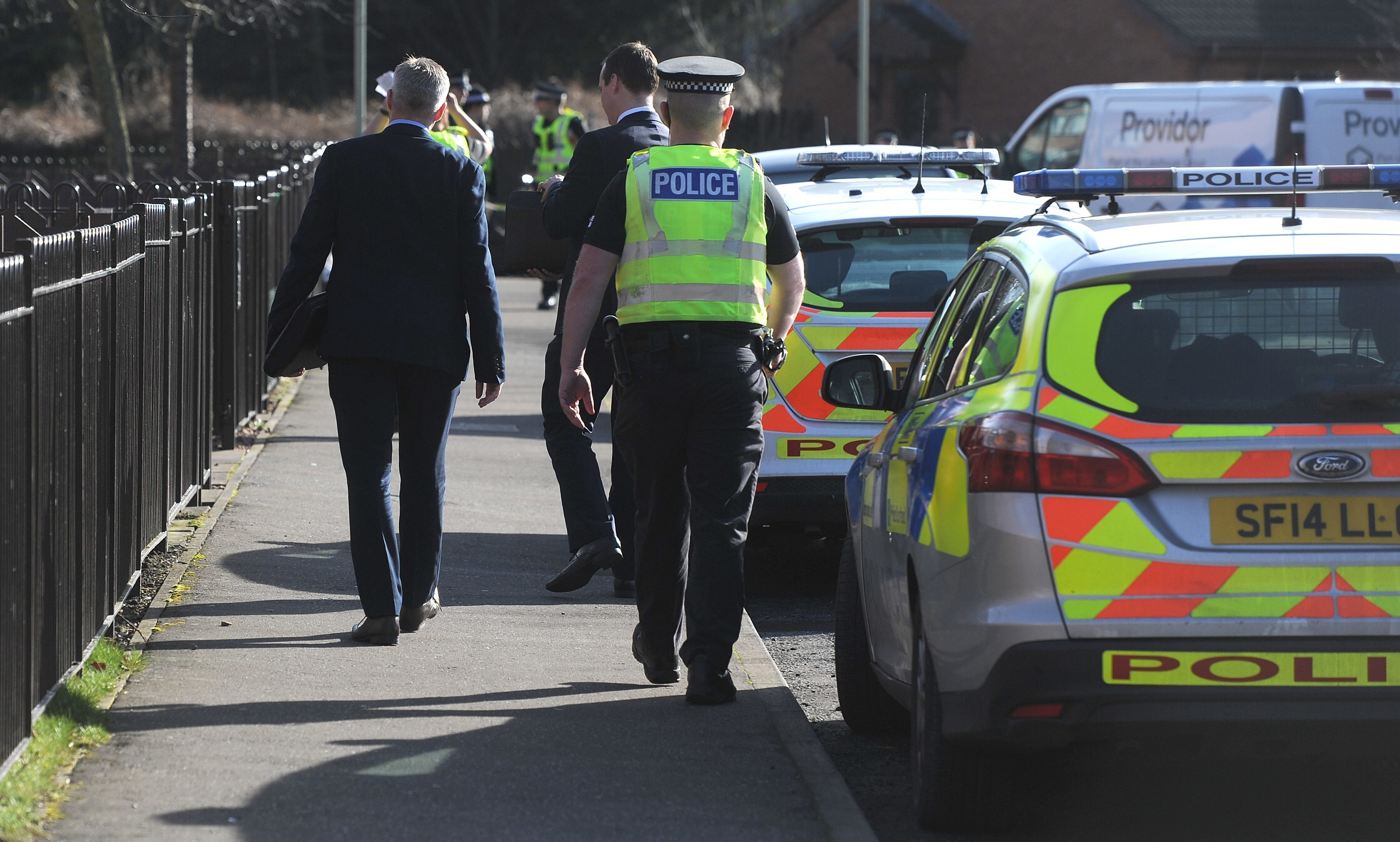 Police outside the property in Drumlanrig Drive after the deaths of Julie McCash and David Sorrie.