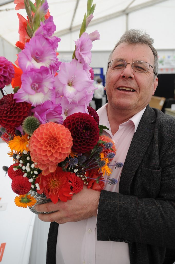 Gordon Robbie with his winning entry in the Thomson Rosebowl (Cut Flowers) competition
