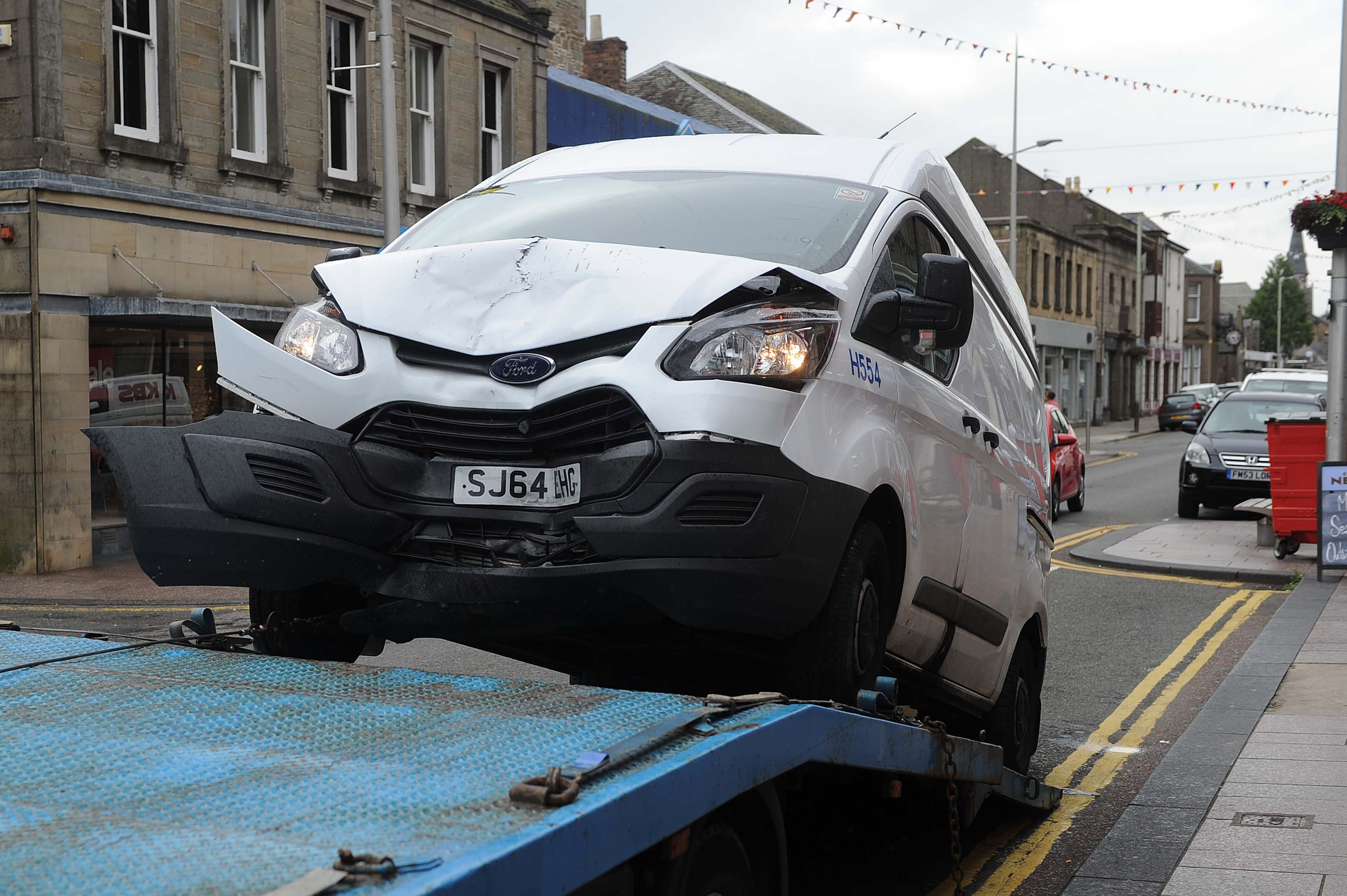A Dundee City Council vehicle being towed away after a collision in Brought Ferry in August.