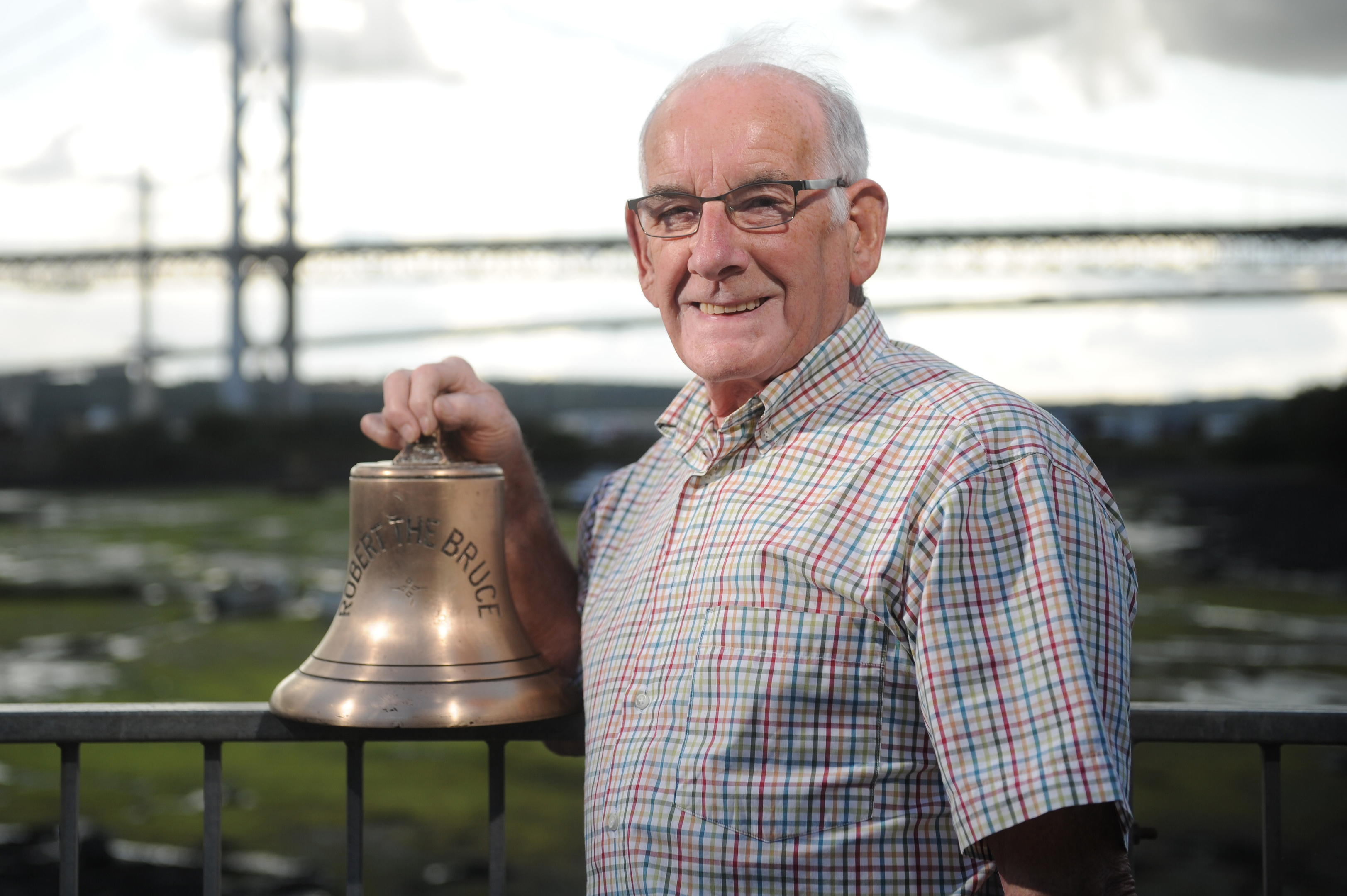 Mr Reid with his ferry bell