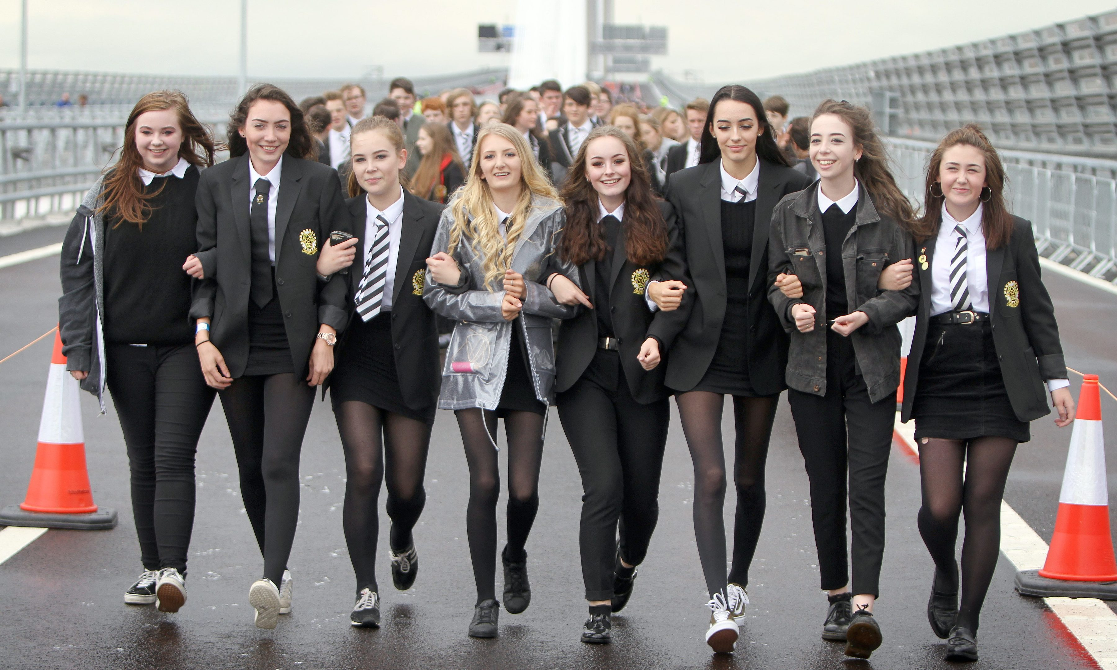 Pupils from Inverkeithing High crossing the bridge.