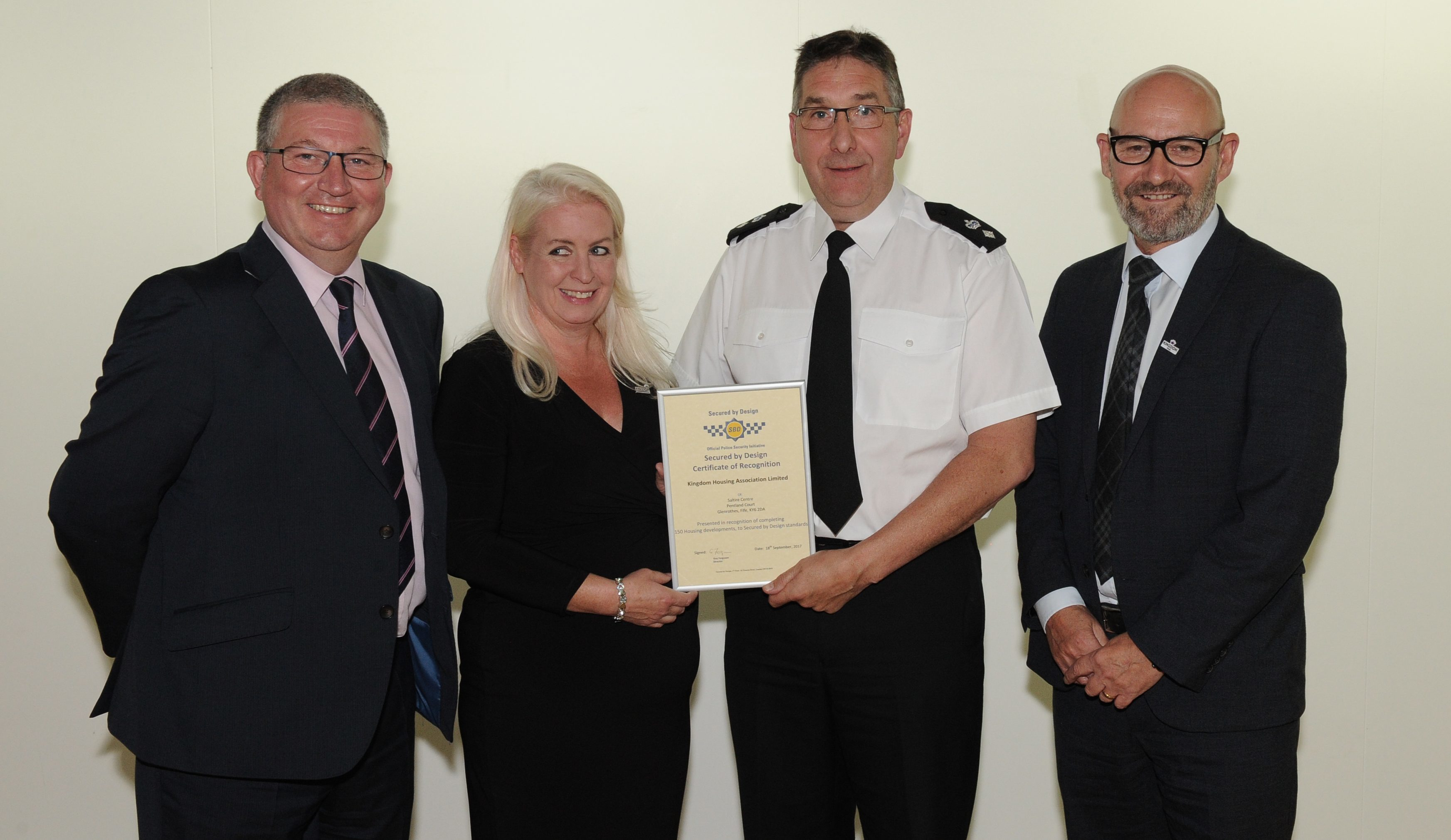 (from left) Stuart Ward, Secured by Design National Designing Out Crime Manager; Kingdom Housing Association Chair, Freya Lees; Police Scotland Divisional Commander, Colin Gall and Kingdom Group Chief Executive, Bill Banks.