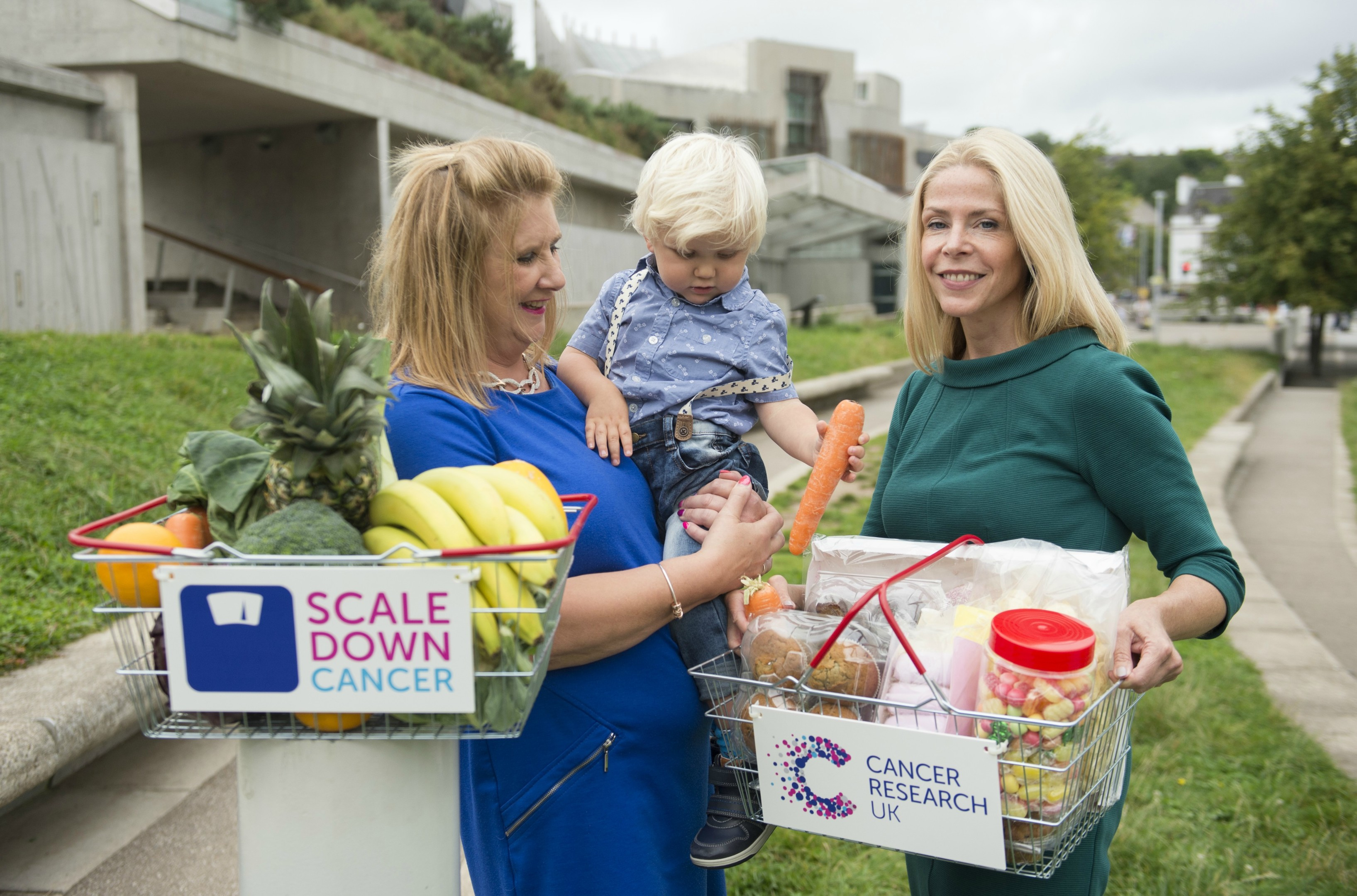 Susan Shaw and grandson Oscar Beatt and Professor Linda Bauld outside the Scottish Parliament
