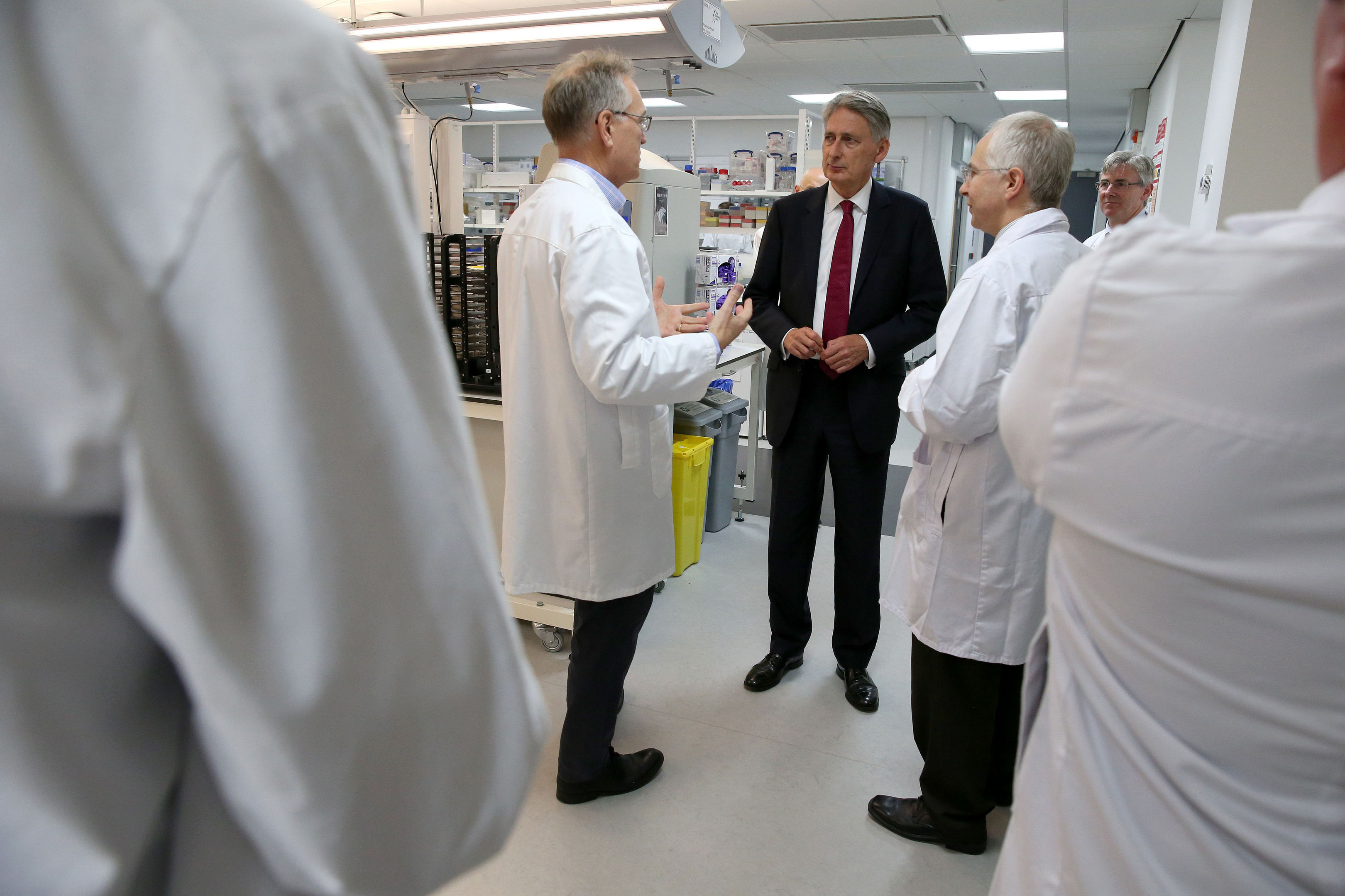 Chancellor Philip Hammond is shown around a lab by Professor Paul Wyatt (left) during a visit to Dundee University's School of Life Sciences.