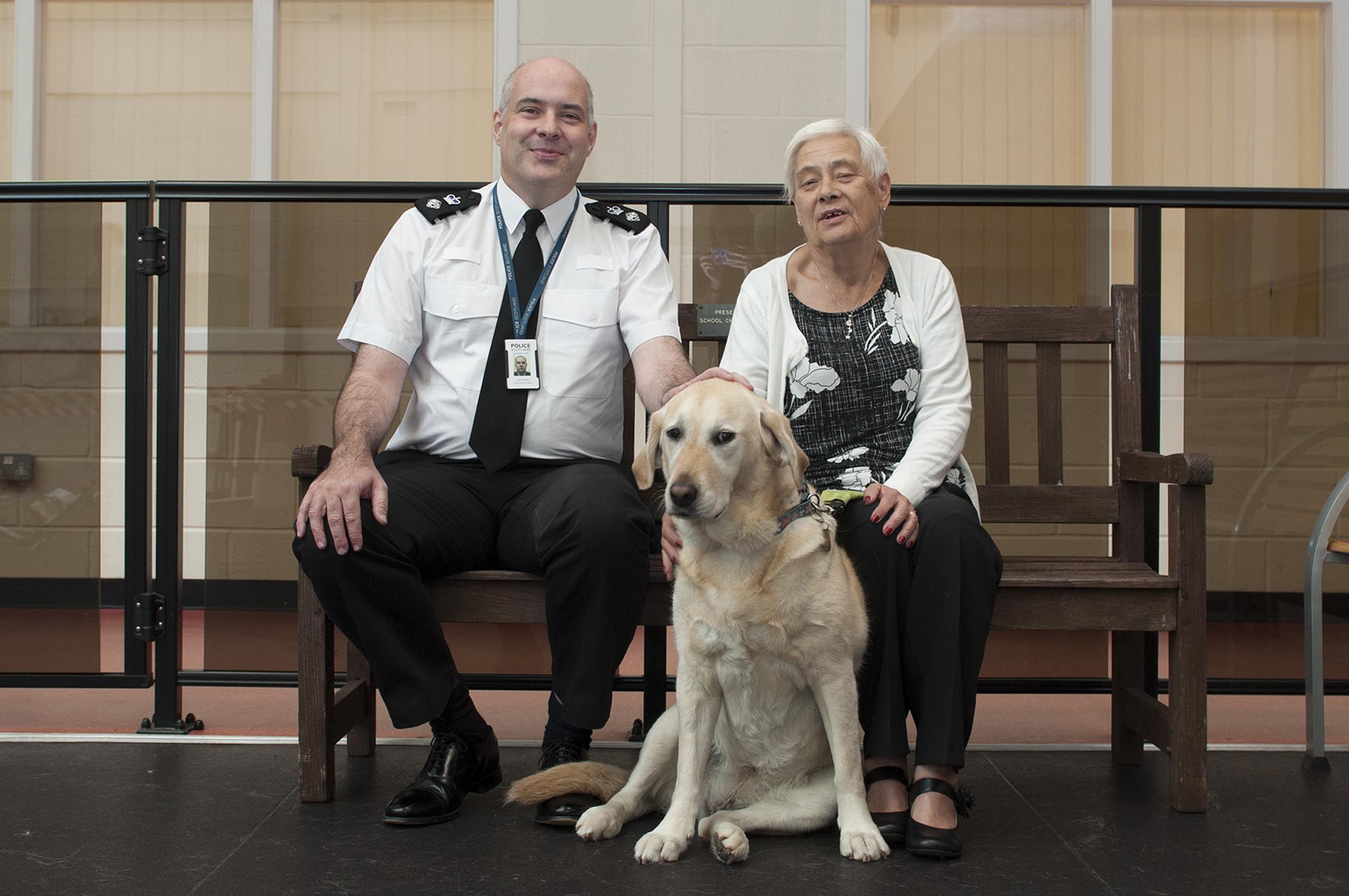Chief Superintendent John McKenzie with Elaine McKenzie and her dog Una, who was attacked by another dog.