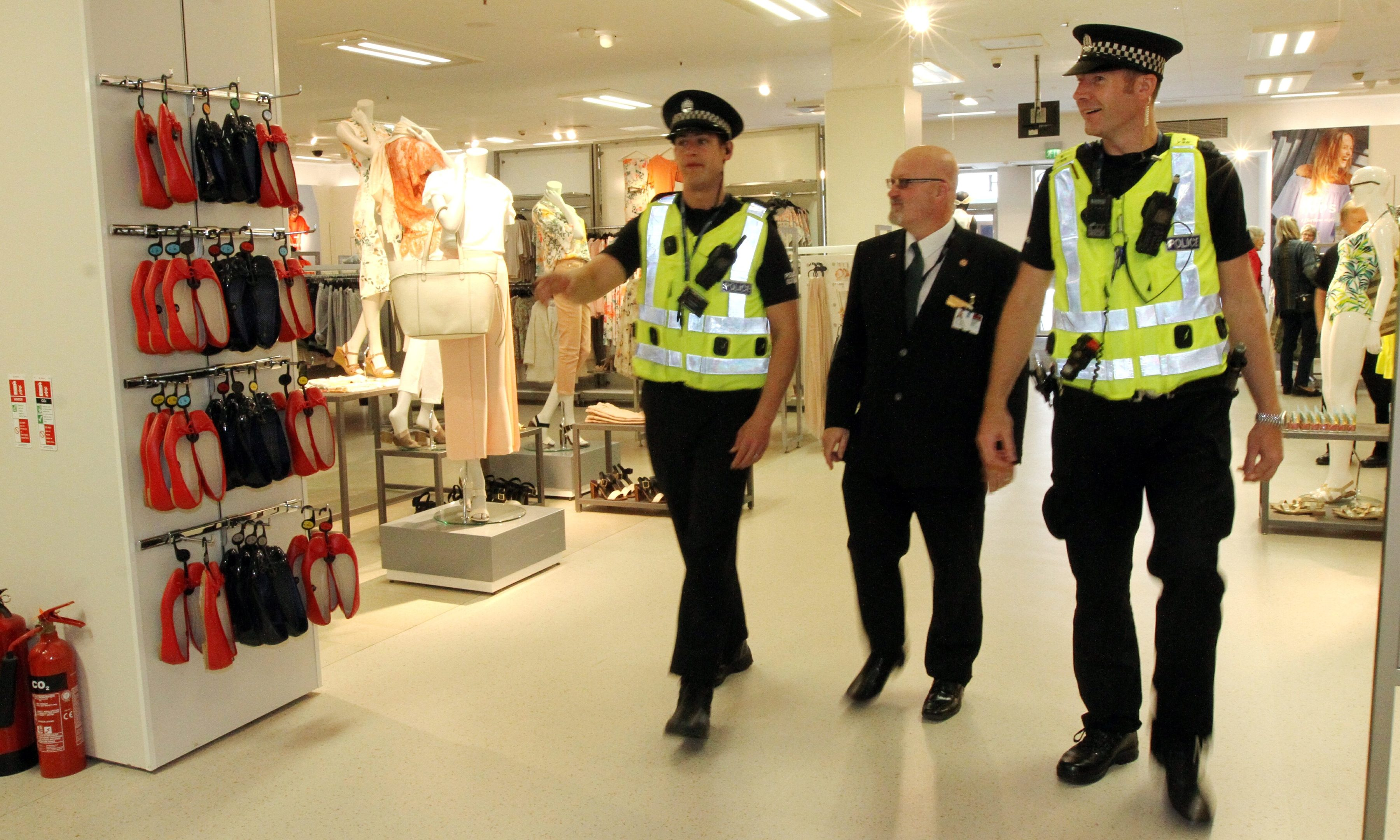 PC Peter Duncan,Paul Nisbett ( M&;S security) and PC Graeme Kerr, take a walk round the Marks & Spencer store, Perth.