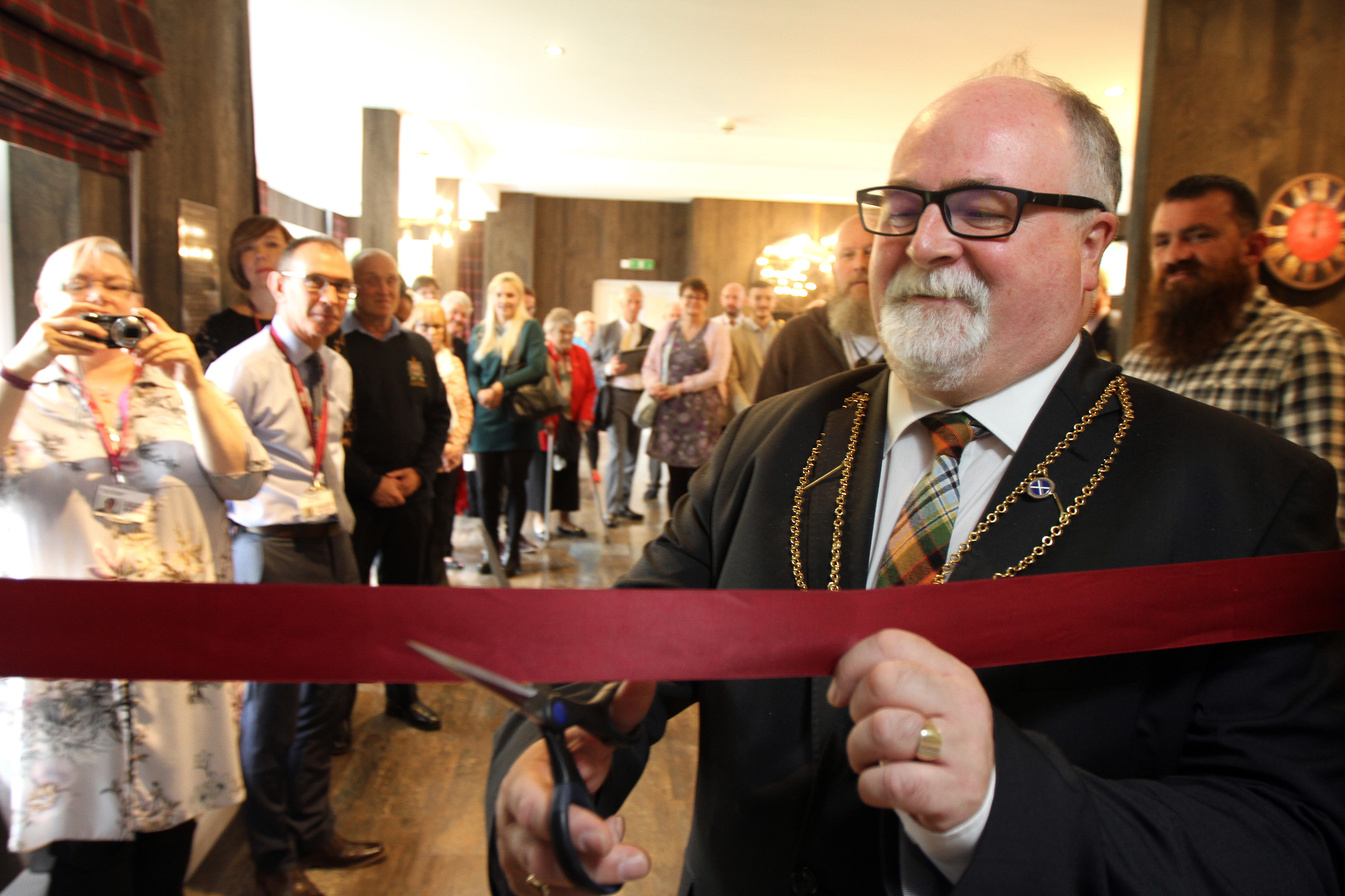 Bill Campbell cutting the ribbon at Rosendael House.