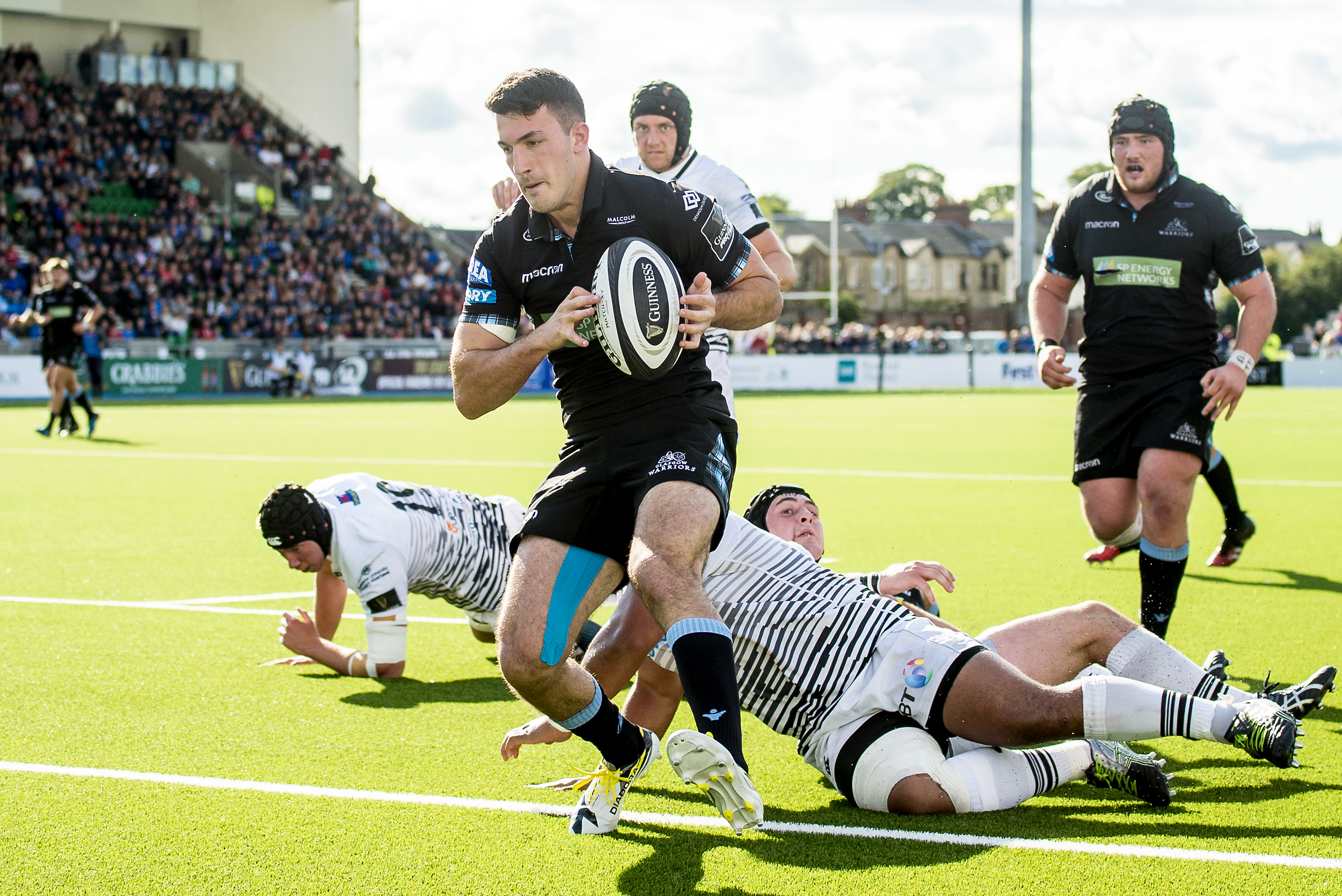 Leo Sarto scores Glasgow's second try against Ospreys. The Warriors are the only unbeaten team in the PRO14 to have won against play-off rivals in the first two rounds.