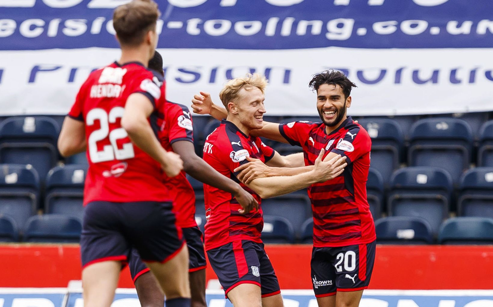 Dundee's Fassial El Bakhtaoui celebrates his goal.