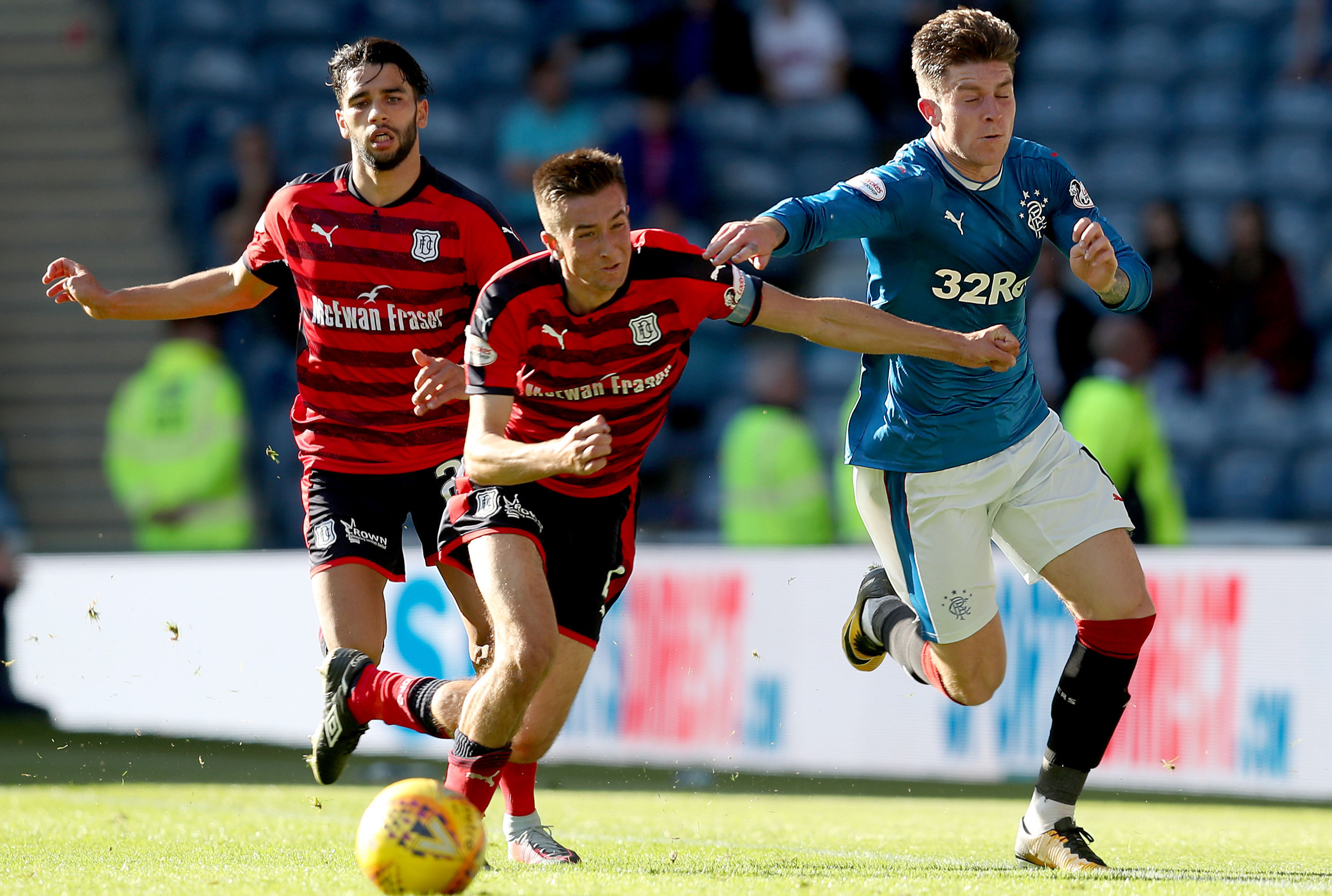 Rangers' Josh Windass and Dundee's Cammy Kerr battle for the ball during the Ladbrokes Scottish Premiership match at Ibrox