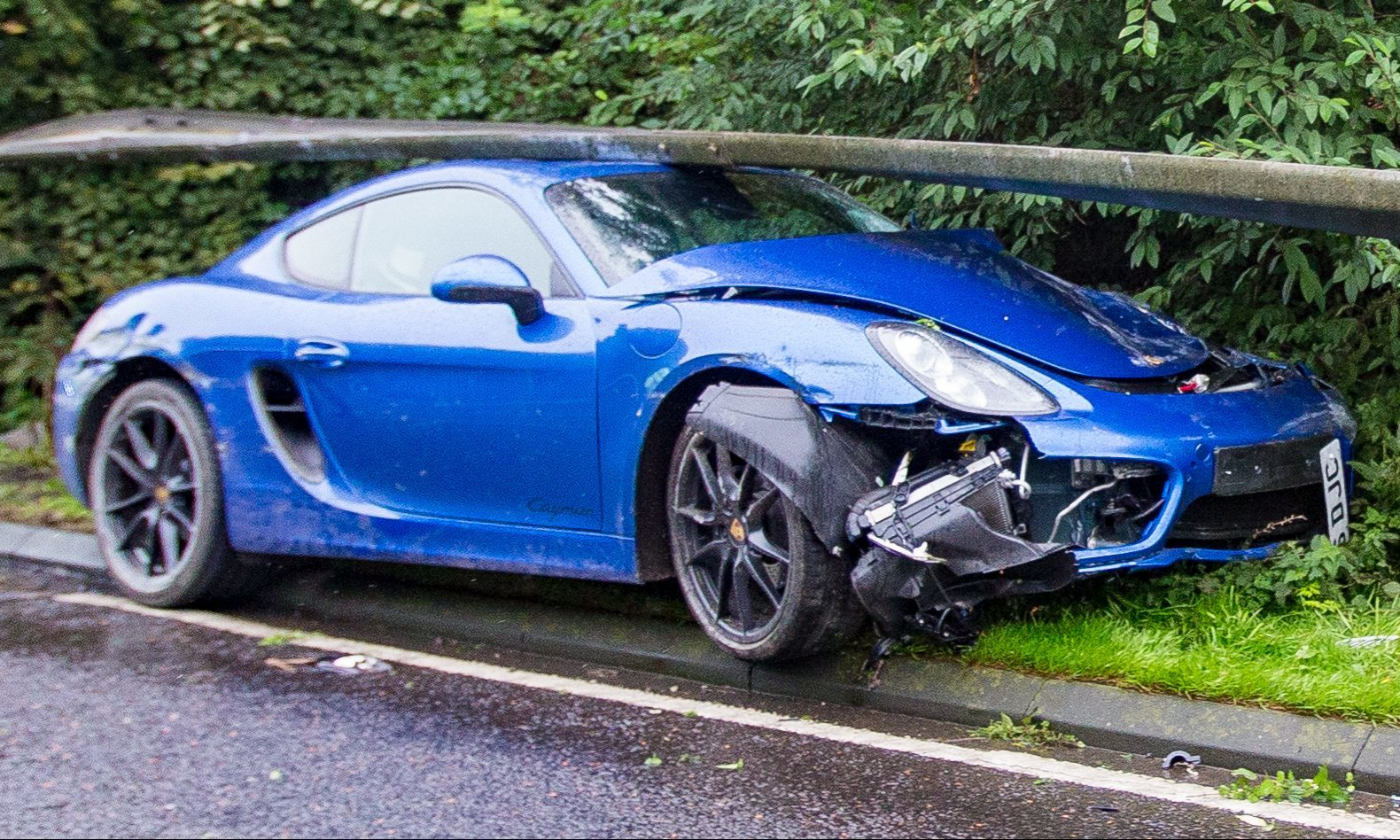 The Porsche sports car was wedged under the barrier on the south side of the bridge.