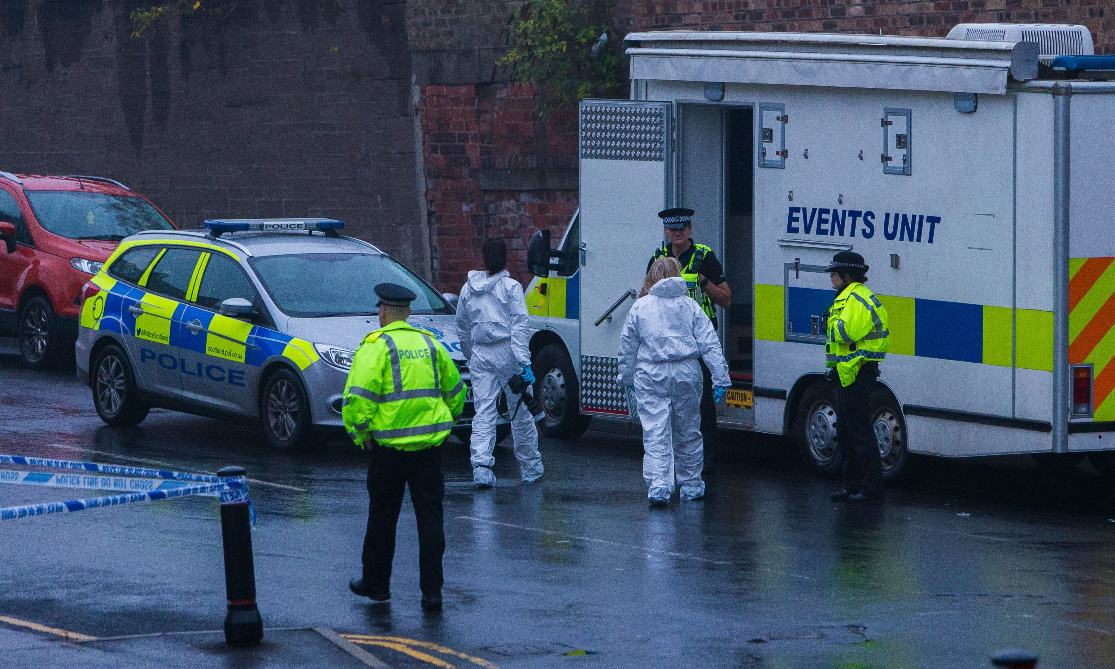 Police and forensics officers at the scene.