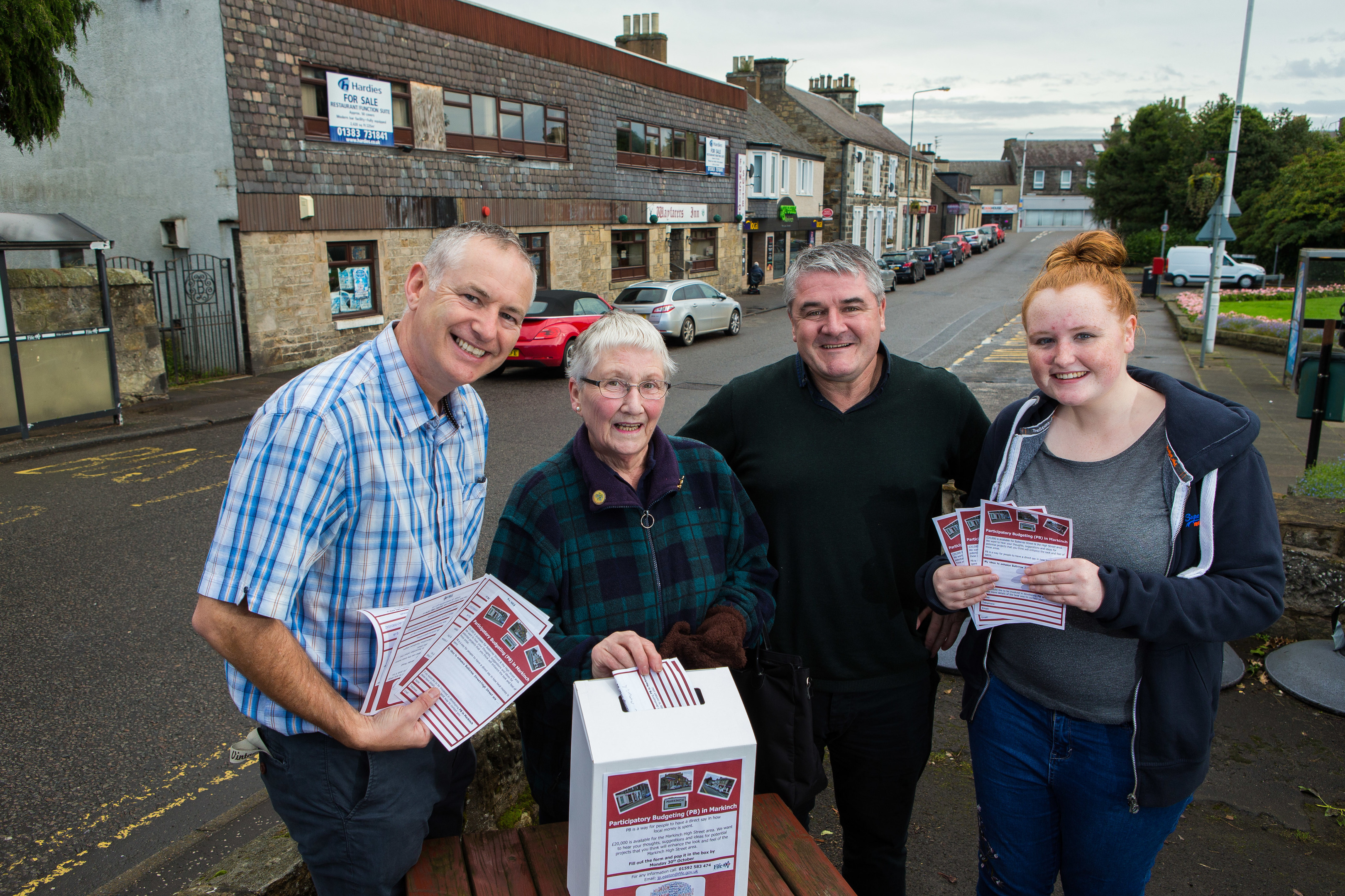 JP Easton (Fife Council), David Hewitt (Fife Council), local resident Marion Law and Modern Apprentice Amy Nicol (19) with the new ballot boxes for ideas on what to spend the £20,000 on.