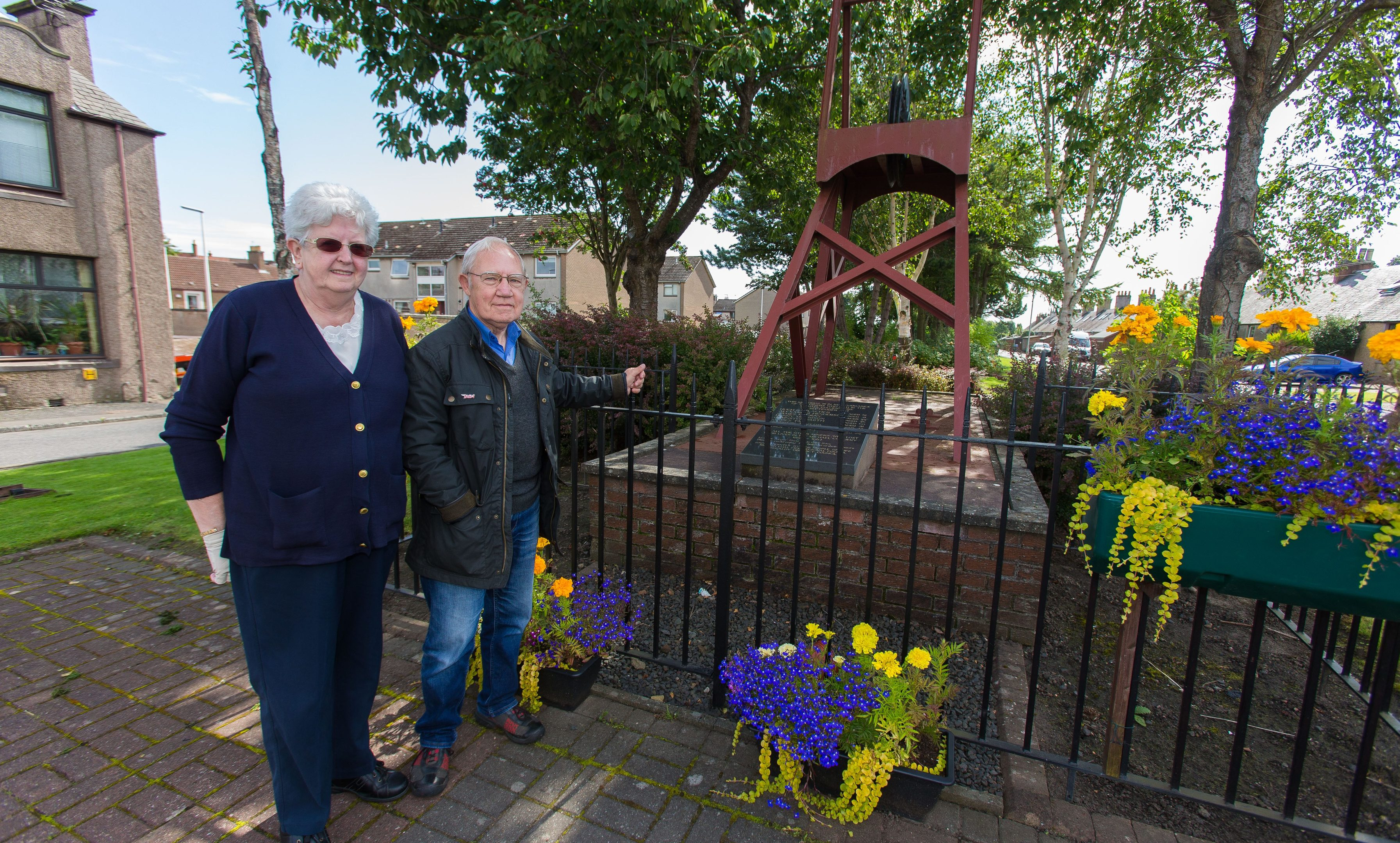 Elizabeth McGuire and Sandy Turner from Fife Mining Preservation Society at the Michael Colliery Memorial before the vandalism