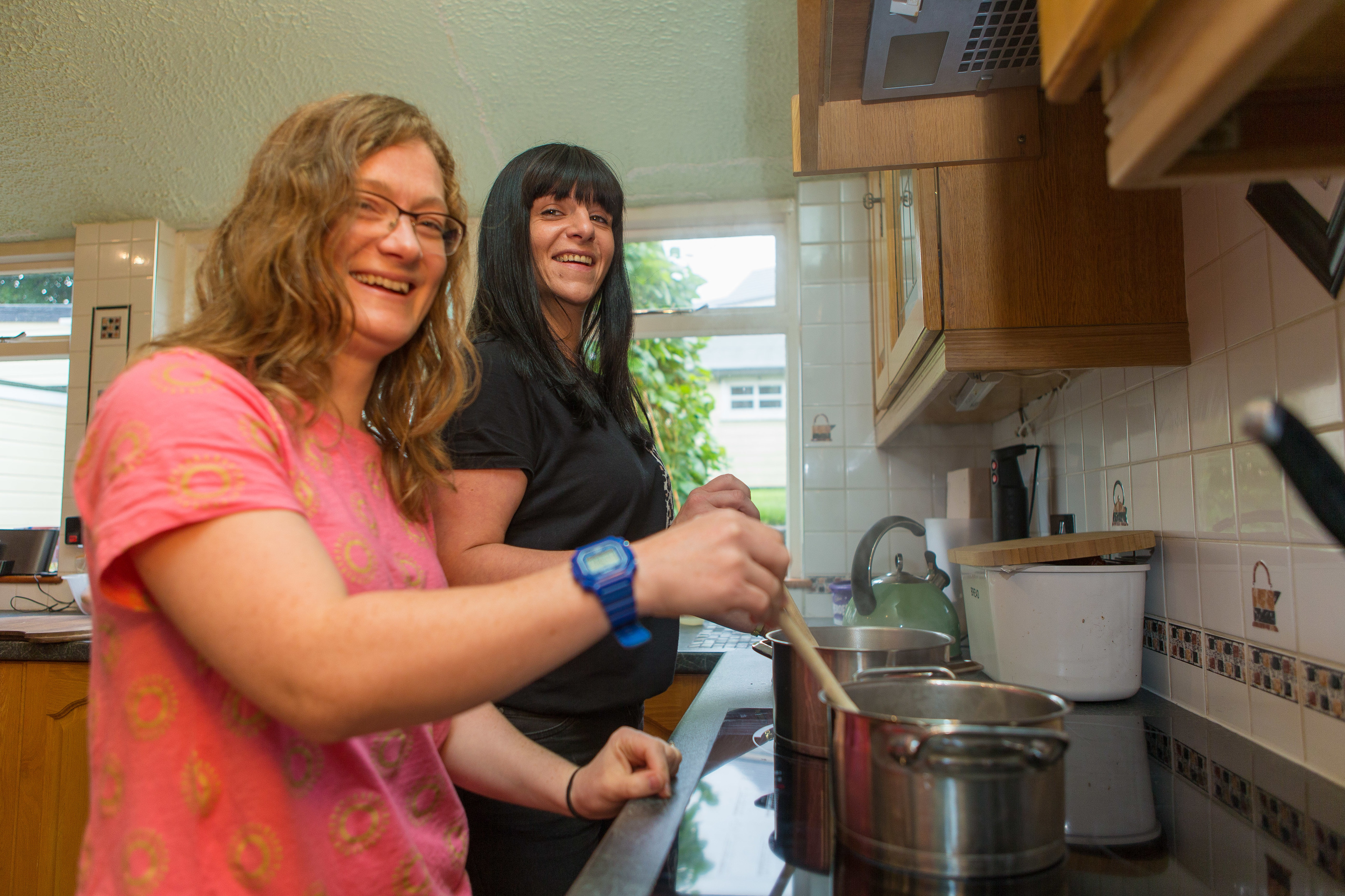 Jennifer Foster, 33,  is a Volunteer Cook with Rhea Long, 34, of The Food Train cooking in the kitchen.