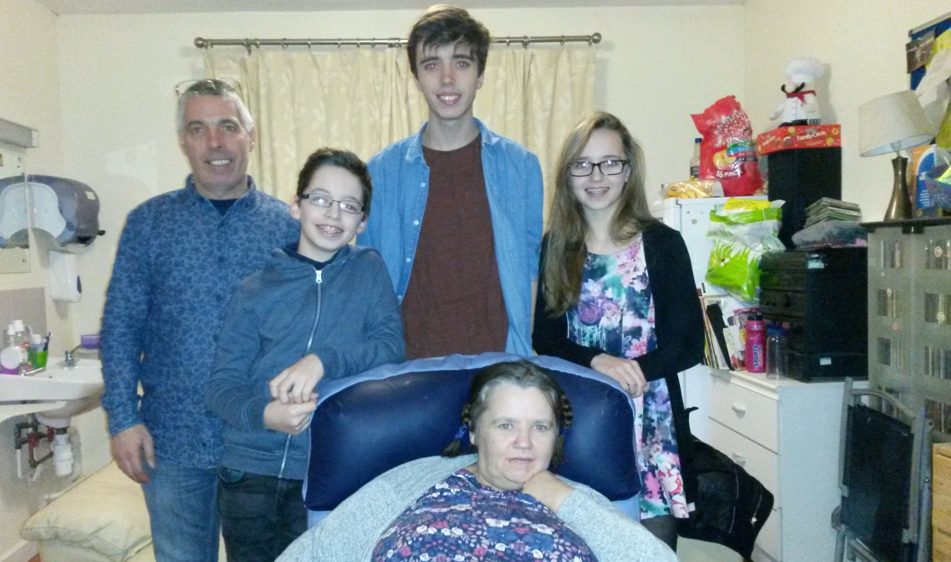 Cameron, centre back, with his family